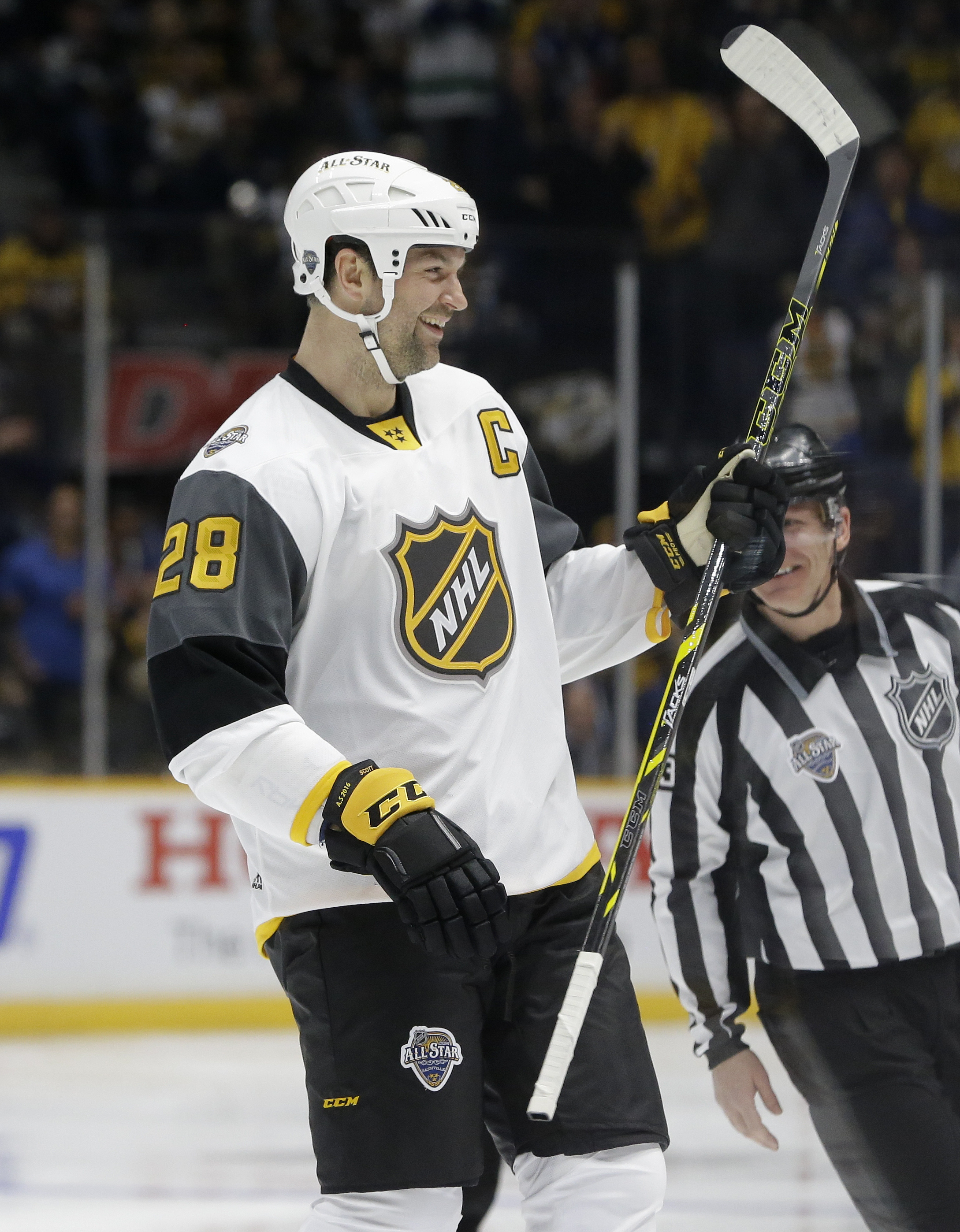 Pacific Division forward John Scott (28) skates to the bench after scoring a goal against the Central Division during an NHL hockey All-Star semifinal round game Sunday, Jan. 31, 2016, in Nashville, Tenn. (AP Photo/Mark Humphrey)