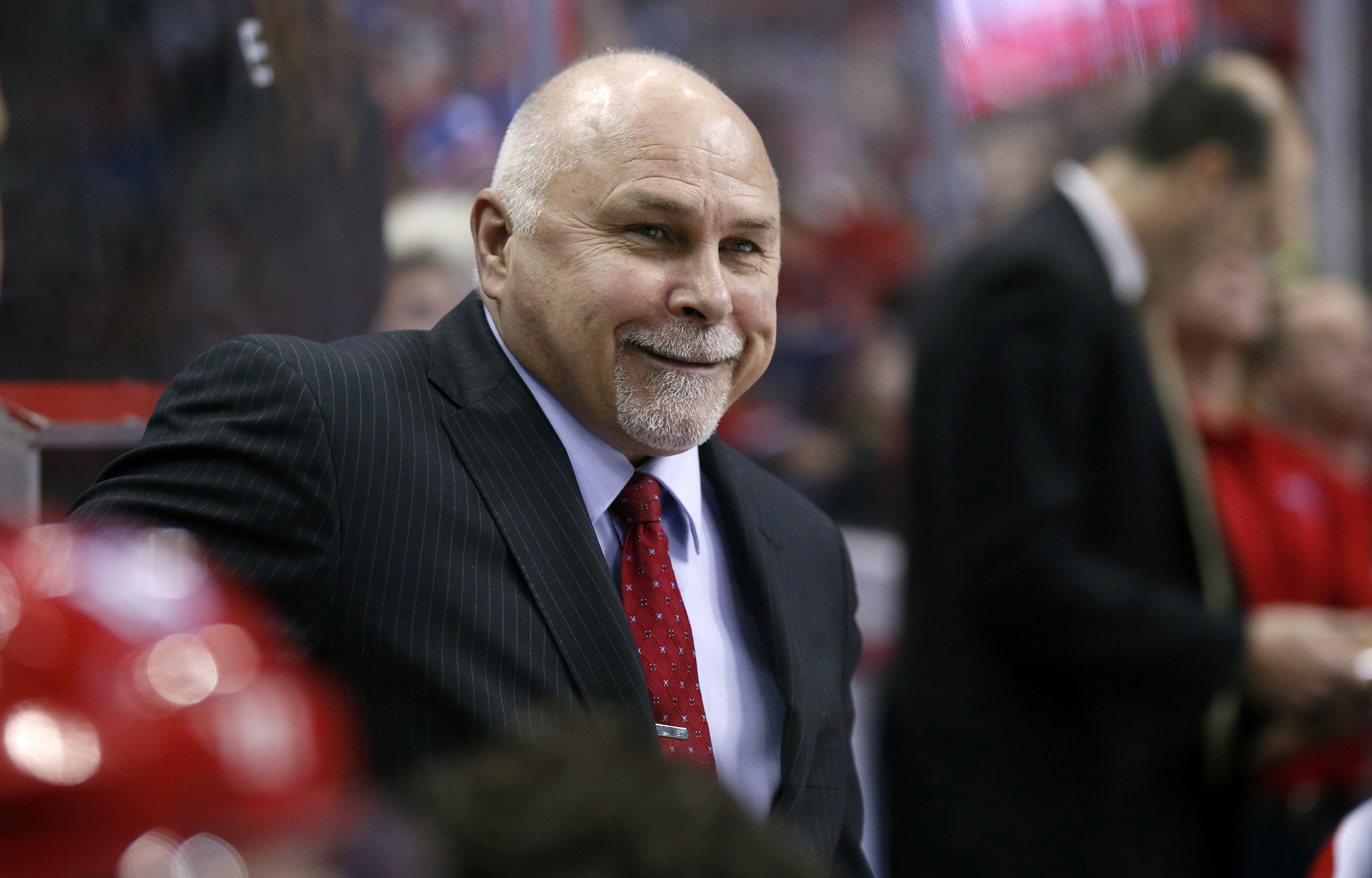FILE - In this Jan. 17, 2016, file photo, Washington Capitals head coach Barry Trotz smiles in the bench in the first period of an NHL hockey game against the New York Rangers in Washington. It looks like Washington is running away with the No. 1 seed in