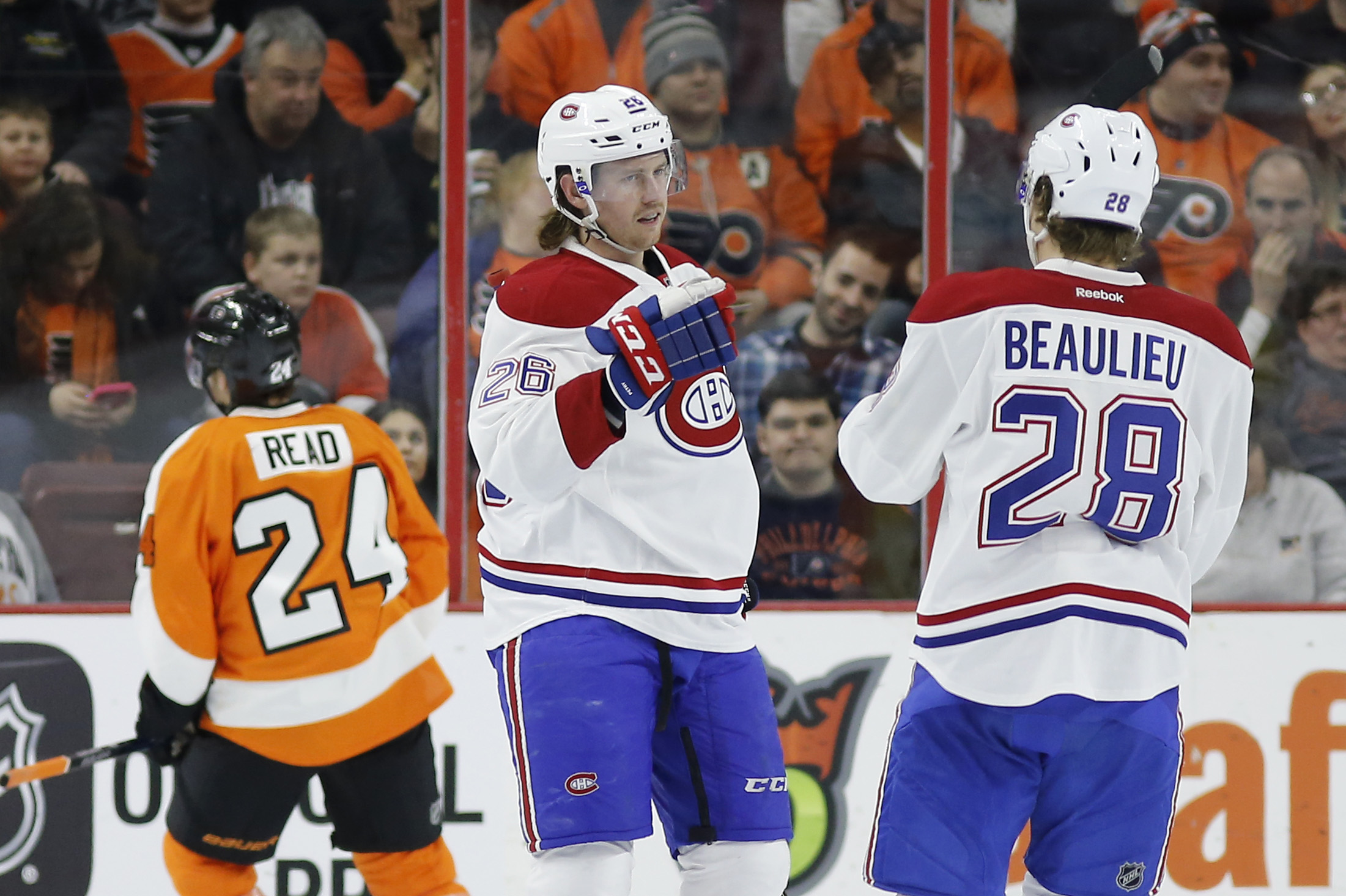 Montreal Canadiens' Jeff Petry (26) and Nathan Beaulieu (28) celebrate after Petry's goal during the second period of an NHL hockey game against the Philadelphia Flyers, Tuesday, Feb. 2, 2016, in Philadelphia. (AP Photo/Matt Slocum)