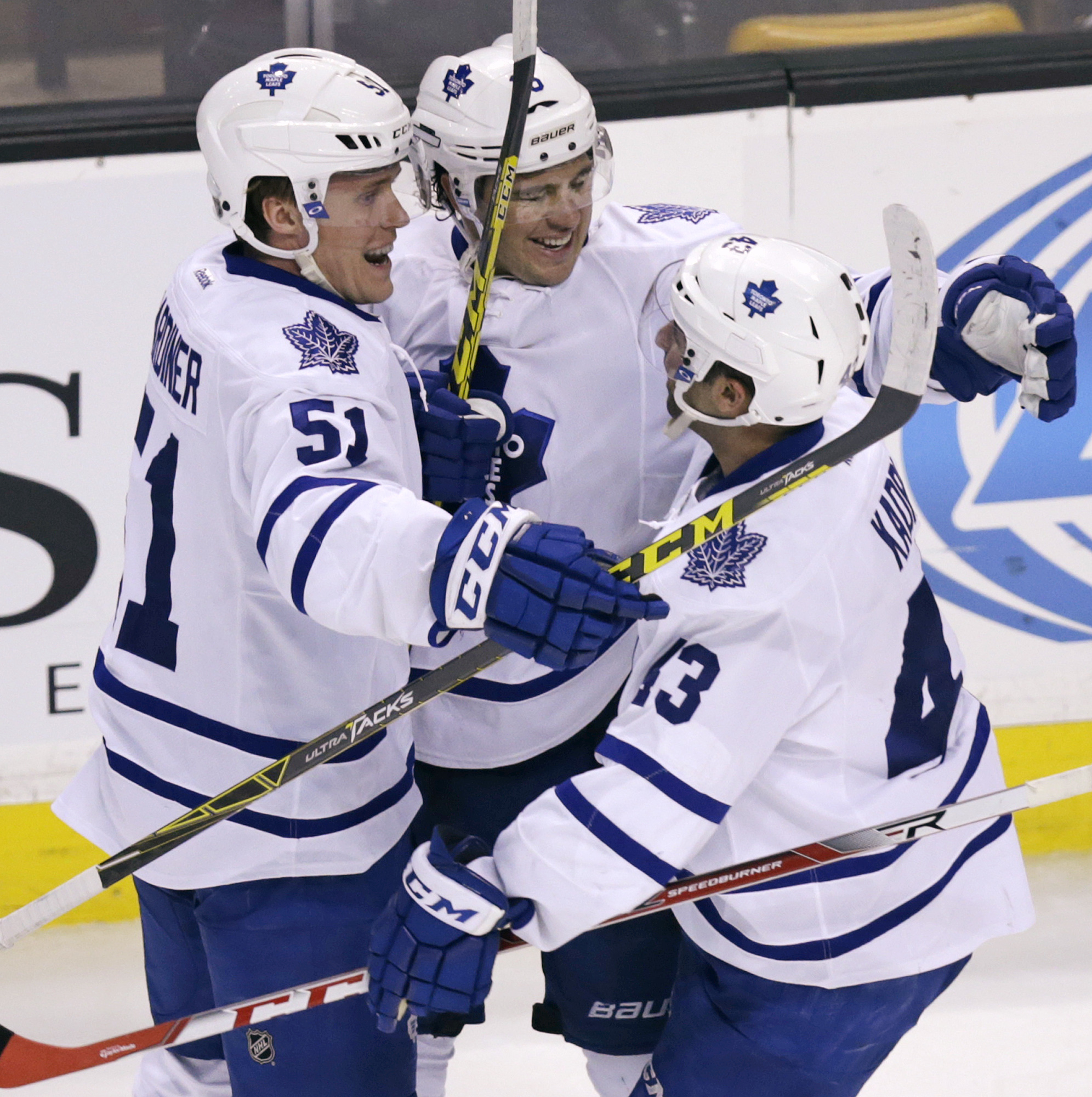 Toronto Maple Leafs right wing P.A. Parenteau, center, is congratulated by Jake Gardiner (51) and Nazem Kadri (43) after his game-winning goal against the Boston Bruins during overtime in an NHL hockey game in Boston, Tuesday, Feb. 2, 2016. Toronto defeat