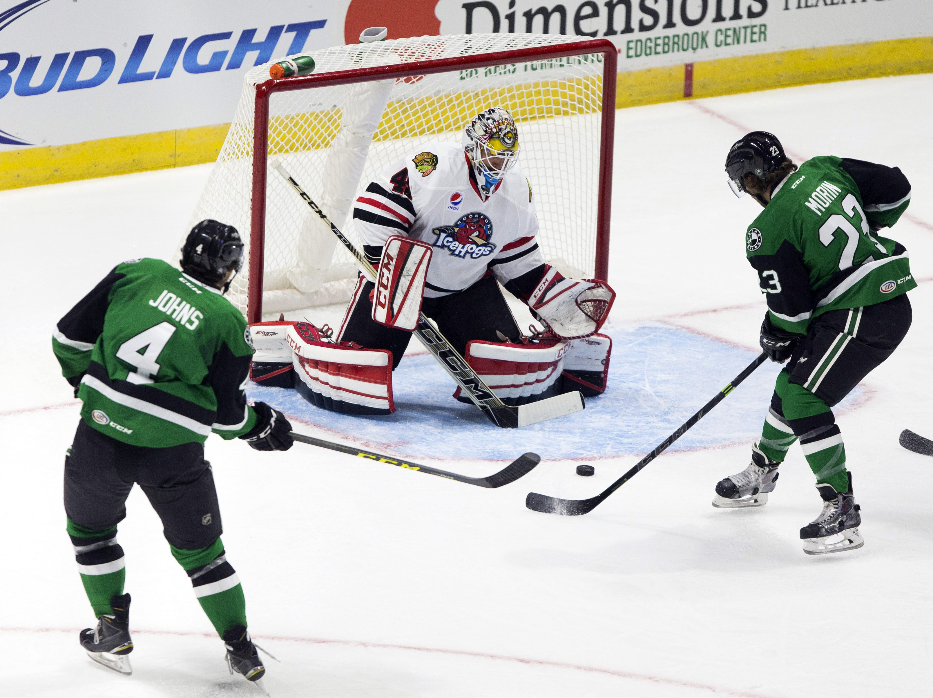 In this photo taken Oct. 17, 2015, Rockford IceHogs goalie Michael Leighton, center, defends the net against the Texas Stars during an AHL hockey game at BMO Harris Bank Center in Rockford, Ill. Leighton is on the verge of breaking the all-time American H