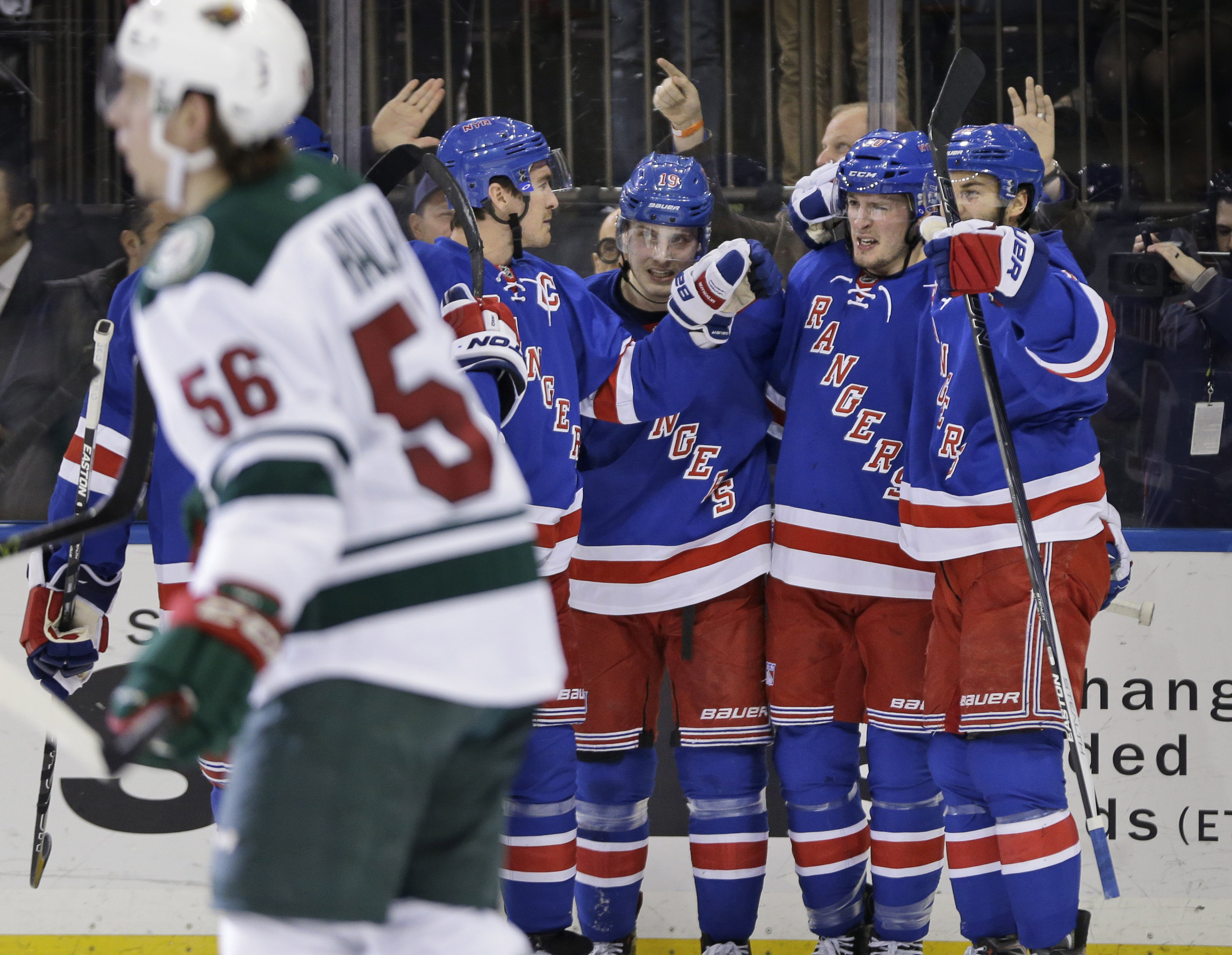 New York Rangers center J.T. Miller (10), second from right, celebrates his goal with teammates during the second period of the NHL hockey game against the Minnesota Wild, Thursday, Feb. 4, 2016, in New York. (AP Photo/Seth Wenig)