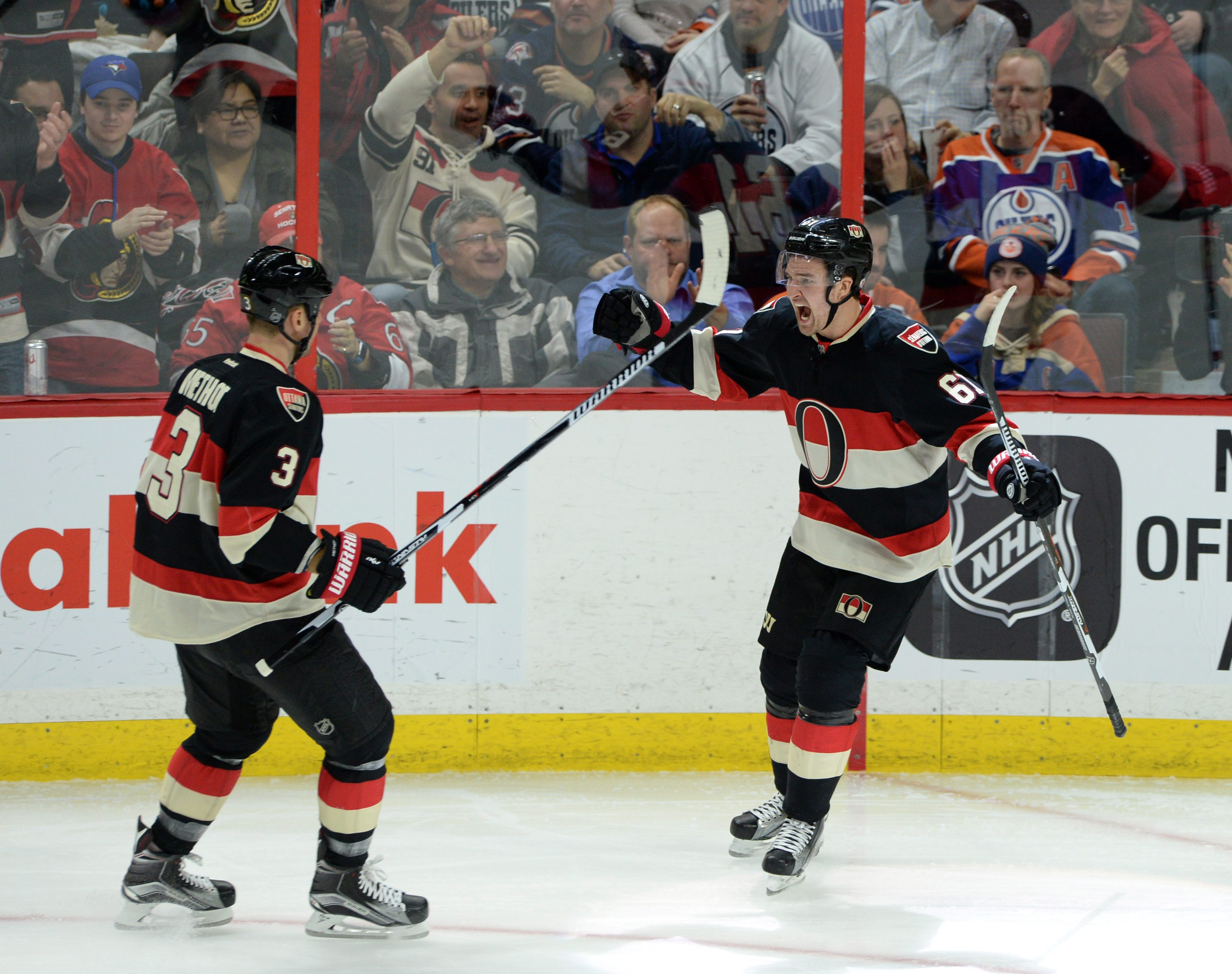 Ottawa Senators' Mark Stone, right, celebrates a goal against the Edmonton Oilers with teammate Marc Methot during the second period of an NHL hockey game, Thursday, Feb. 4, 2016 in Ottawa, Ontario. (Sean Kilpatrick/The Canadian Press via AP) MANDATORY CR