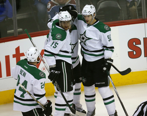 Dallas Stars center Jason Spezza, right, celebrates scoring a goal with, from left, and defensemen Jordie Benn and Patrik Nemeth, of Sweden, and right wing Patrick Eaves against the Colorado Avalanche in the first period of an NHL hockey game Thursday, Fe