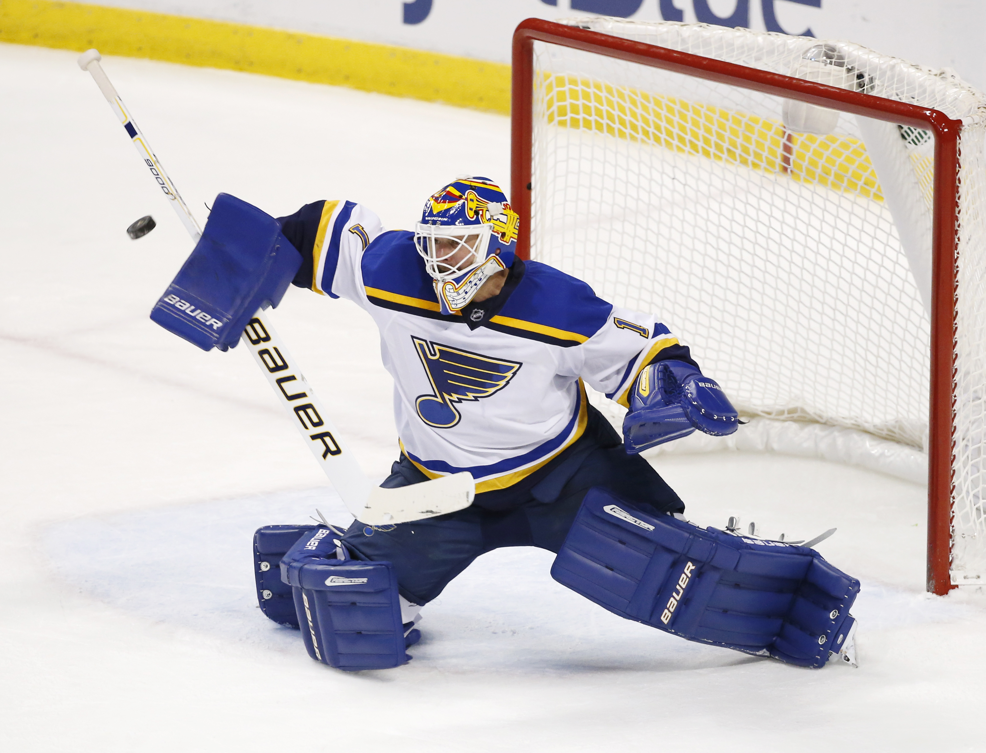 St. Louis Blues goalie Brian Elliott (1) deflects a shot during the second period of an NHL hockey game against the Florida Panthers, Friday, Feb. 12, 2016, in Sunrise, Fla. (AP Photo/Wilfredo Lee)