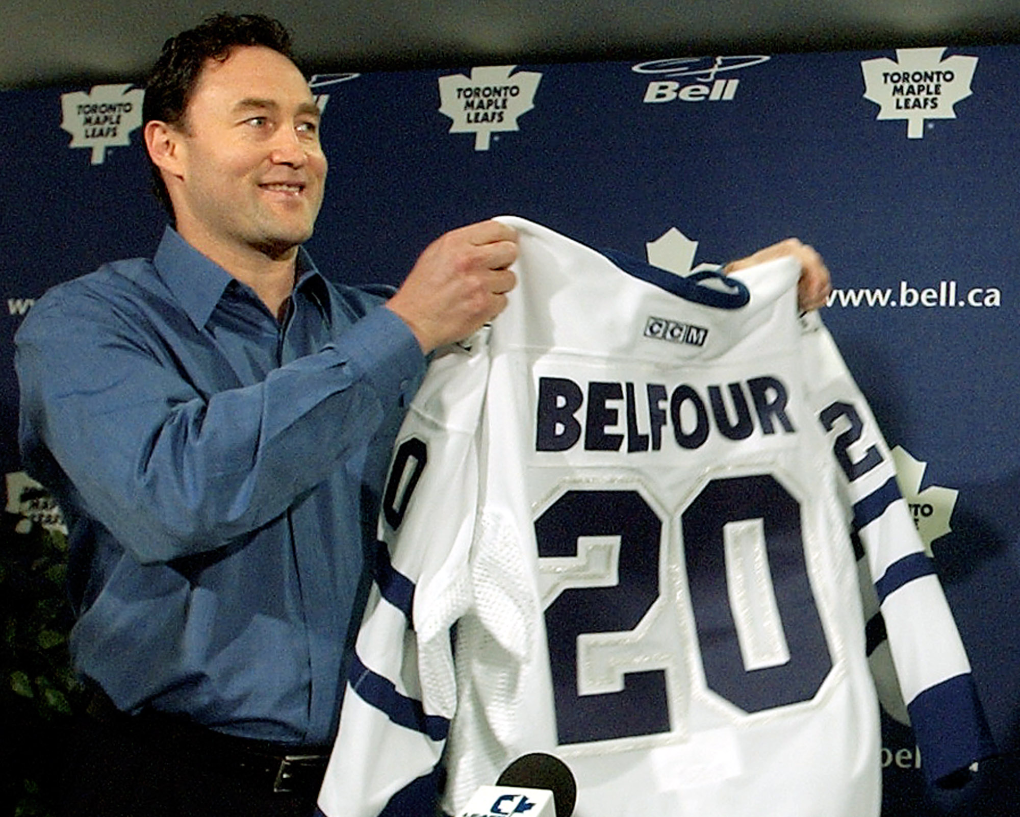 FILE - In this July 3, 2002, new Maple Leafs goaltender Ed Belfour receives his number 20 jersey at a news conference in Toronto. Ed Belfour is preparing to give up his Olympic gold medal for an opportunity to go into business with his son. The medal the