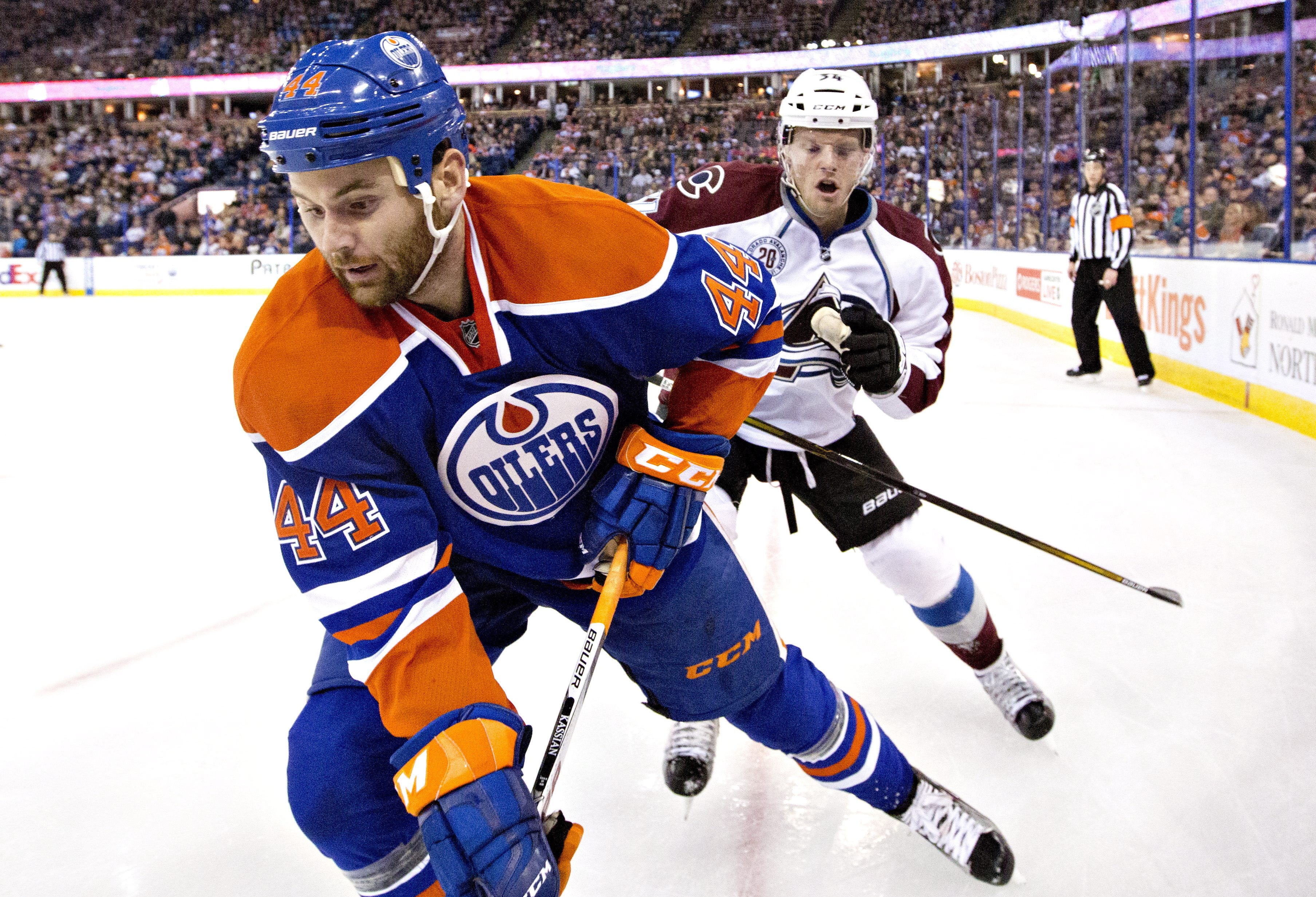 Colorado Avalanche's Carl Soderberg (34) battles in the corner with Edmonton Oilers' Zack Kassian (44) during the second period of an NHL hockey game Saturday, Feb. 20, 2016, in Edmonton, Alberta. (Jason Franson/The Canadian Press via AP)