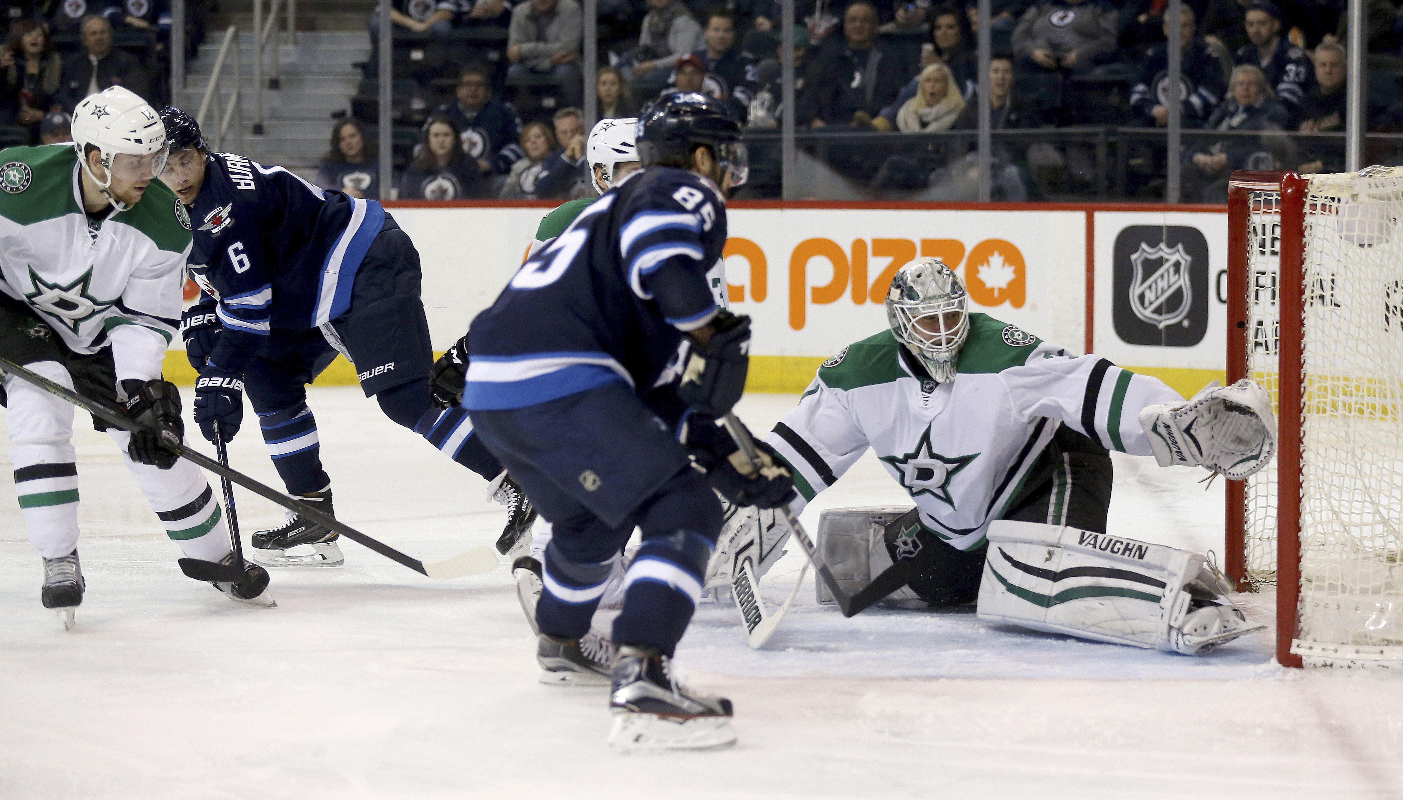 Winnipeg Jets' Alexander Burmistrov (6) scores on Dallas Stars goaltender Antti Niemi (31) during the second period of an NHL hockey game Tuesday, Feb. 23, 2016, in Winnipeg, Manitoba. (Trevor Hagan/The Canadian Press via AP)