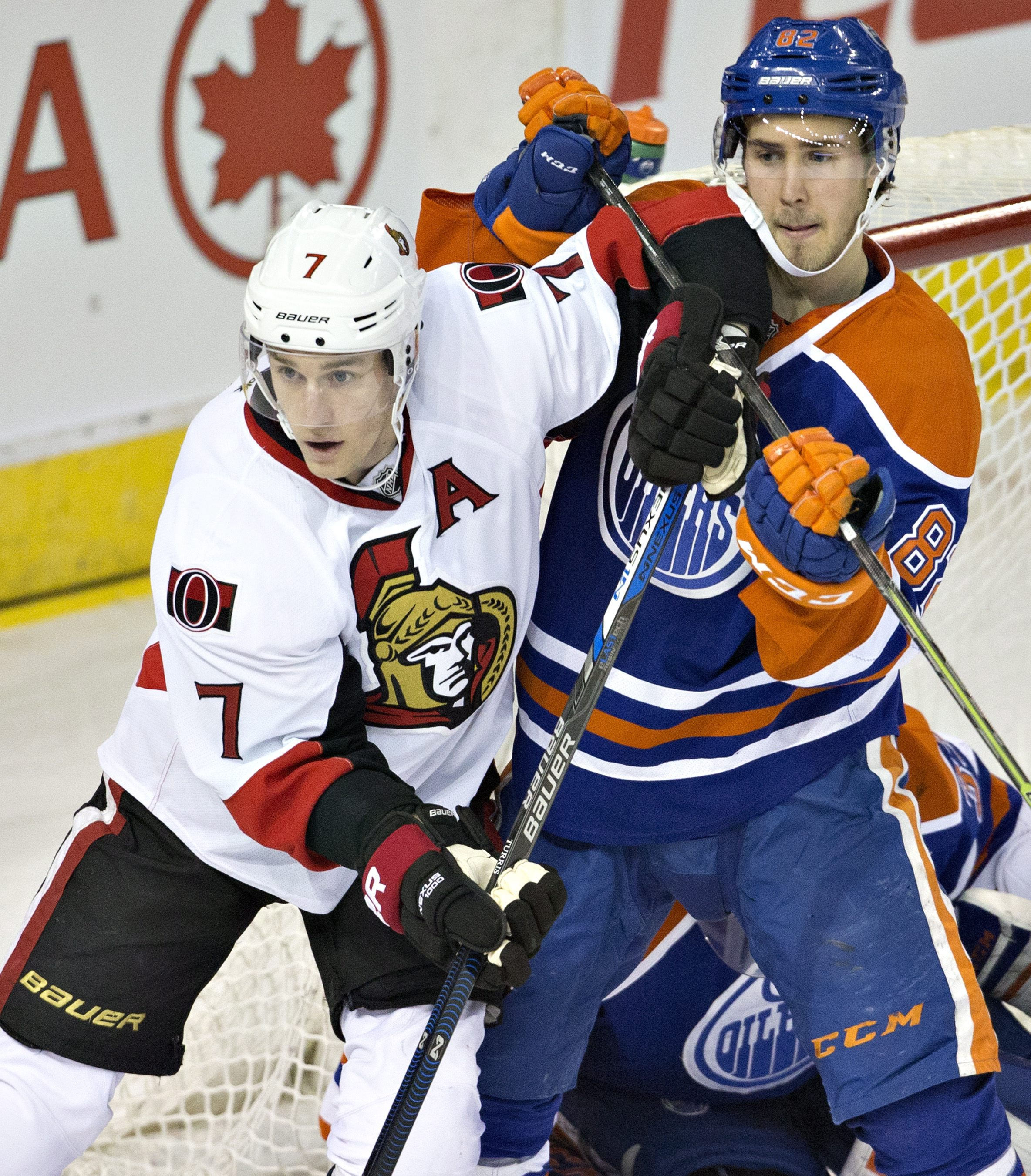 Ottawa Senators' Kyle Turris (7) and Edmonton Oilers' Jordan Oesterle (82) battle in front of the net during second period of an NHL hockey game in Edmonton, Alberta, Tuesday, Feb. 23, 2016. (Jason Franson/The Canadian Press via AP) MANDATORY CREDIT