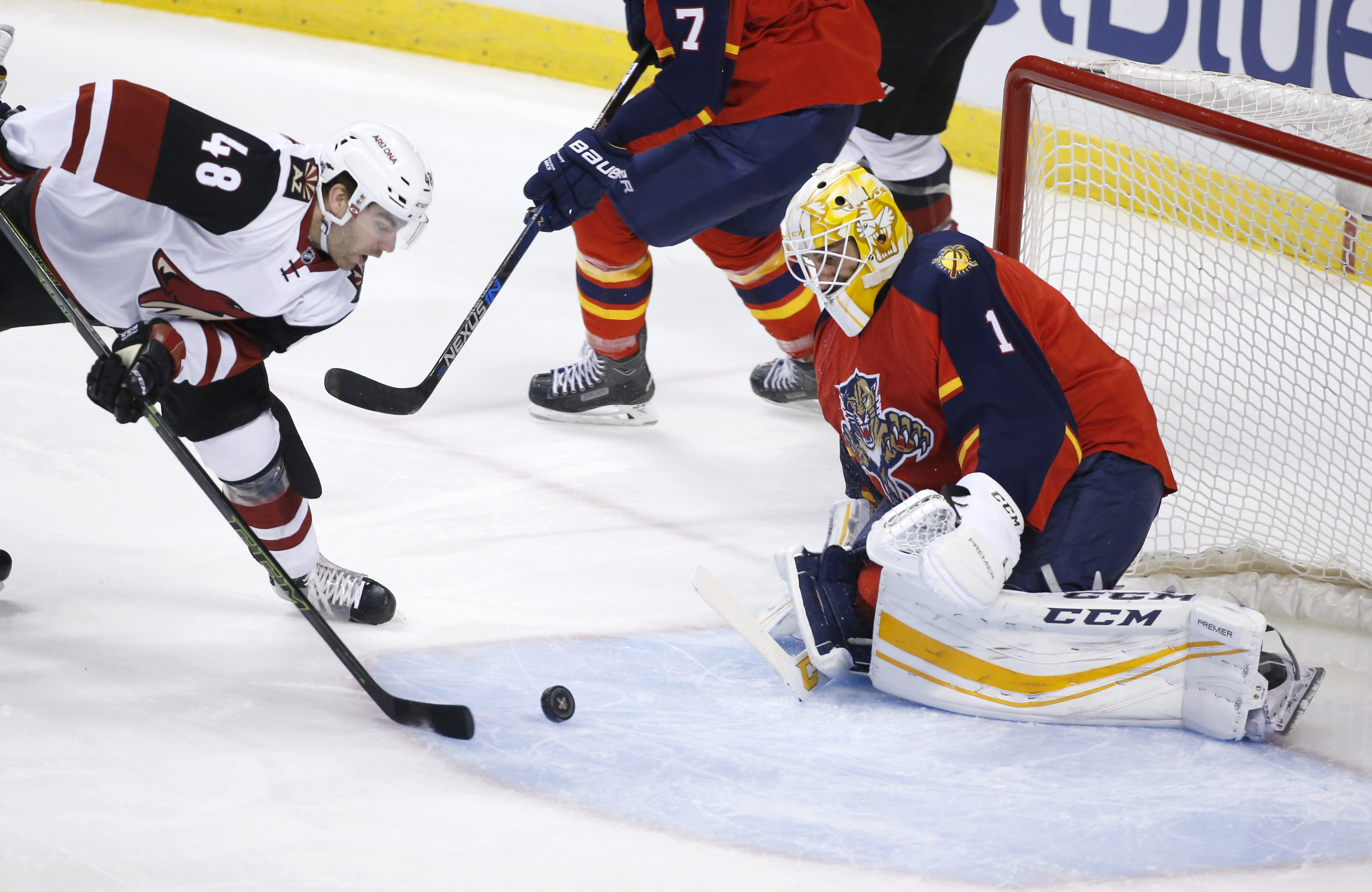 Arizona Coyotes left wing Jordan Martinook (48) attempts a shot against Florida Panthers goalie Roberto Luongo (1) during the first period of an NHL hockey game, Thursday, Feb. 25, 2016 in Sunrise, Fla. (AP Photo/Wilfredo Lee)
