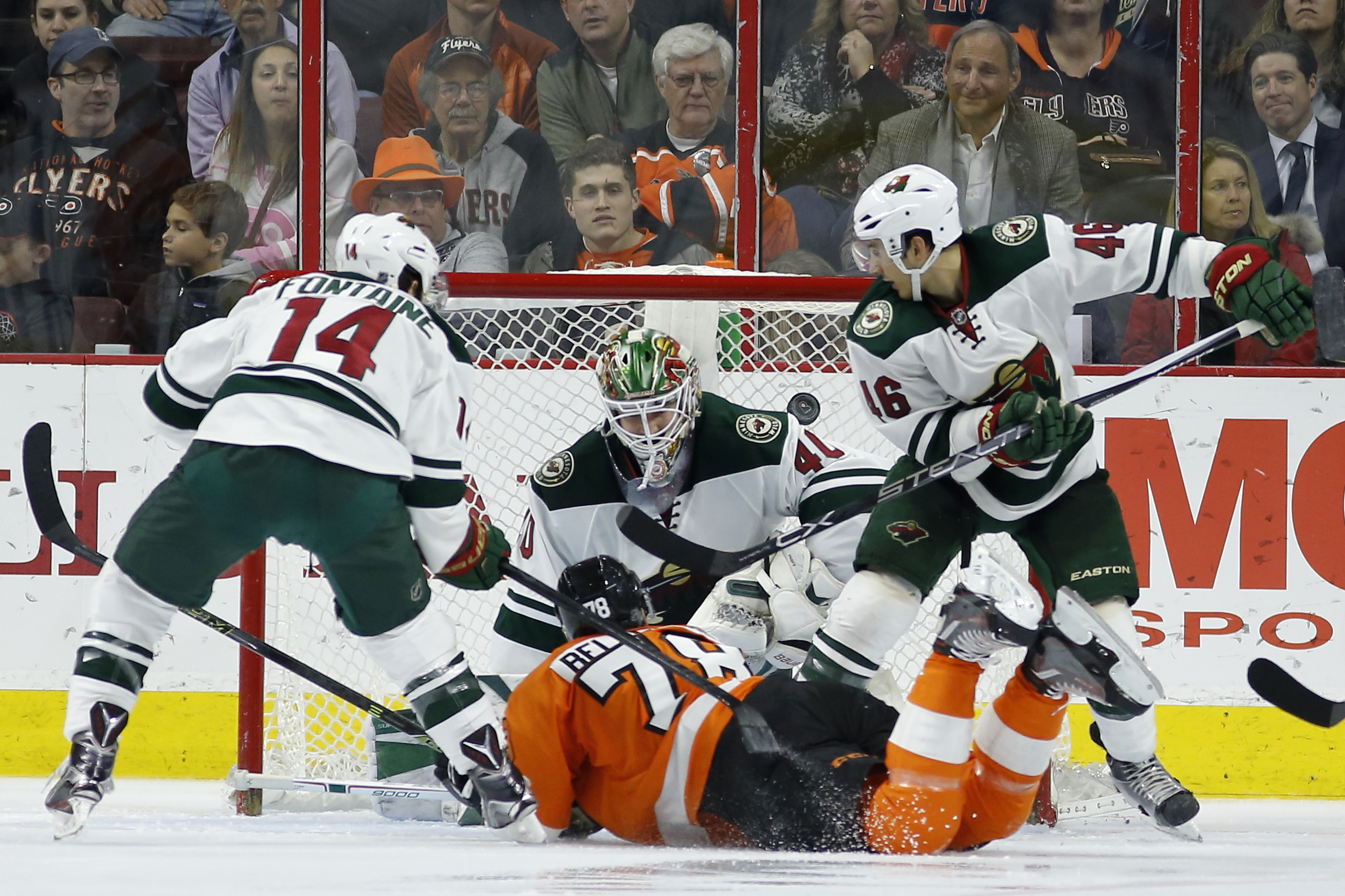 Philadelphia Flyers' Pierre-Edouard Bellemare (78) scores a goal past Minnesota Wild's Devan Dubnyk (40) as Justin Fontaine (14) and Jared Spurgeon (46) defend during the third period of an NHL hockey game, Thursday, Feb. 25, 2016, in Philadelphia. Philad