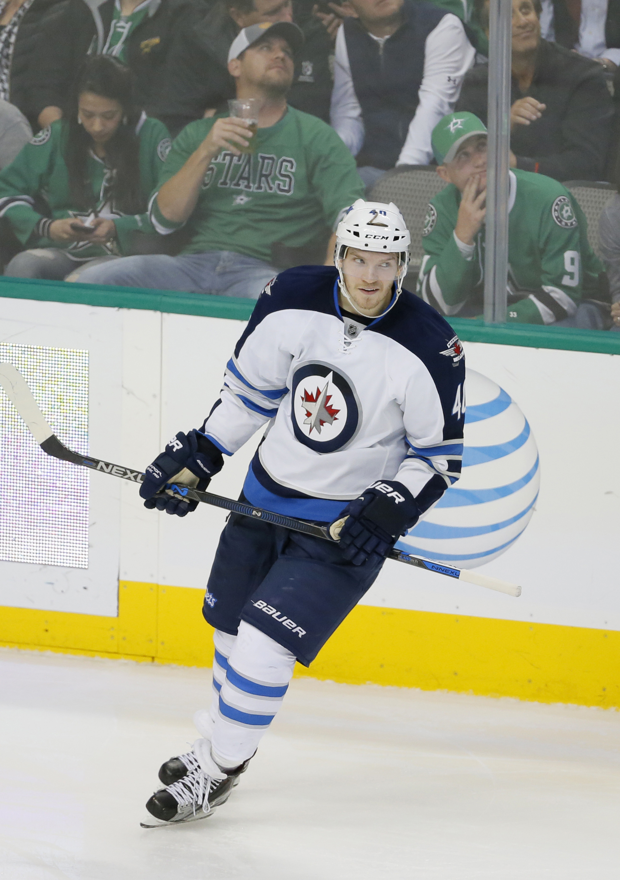 Winnipeg Jets' Joel Armia (40) of Finland skates back to the bench after scoring a goal against the Dallas Stars in the third period of an NHL hockey game, Thursday, Feb. 25, 2016, in Dallas. The Jets won 6-3. (AP Photo/Tony Gutierrez)