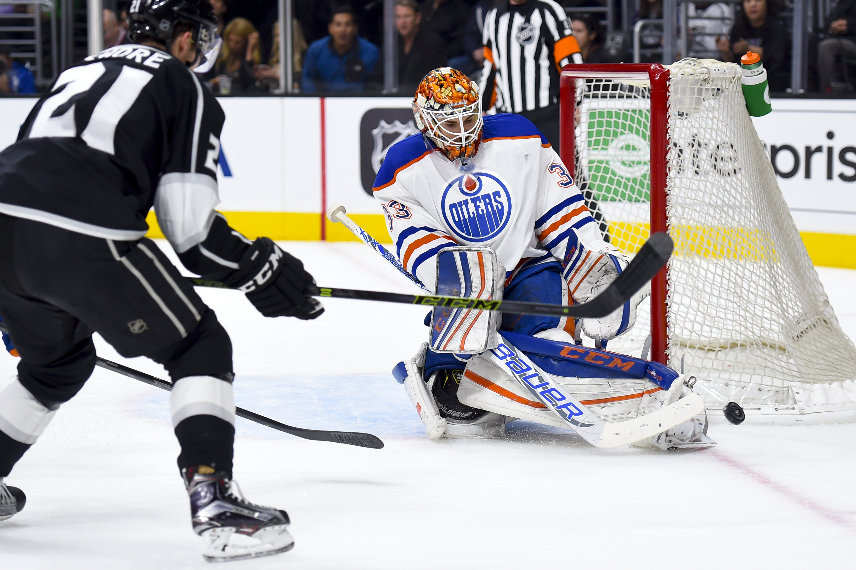 Edmonton Oilers goalie Cam Talbot (33) blocks a shot from Los Angeles Kings center Nick Shore (21) during the second period of an NHL hockey game Thursday, Feb. 25, 2016, in Los Angeles. (AP Photo/Gus Ruelas)