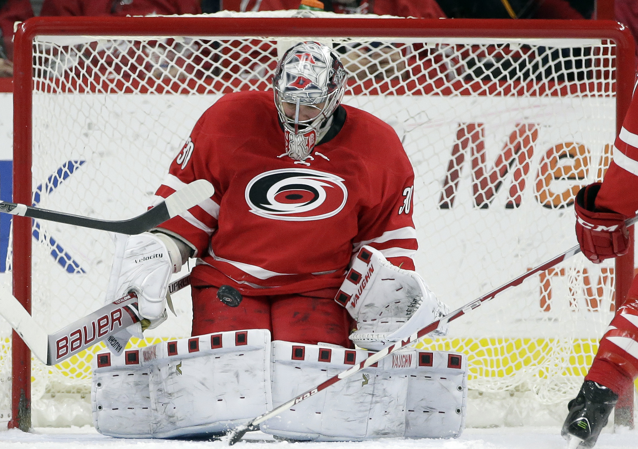 Carolina Hurricanes goalie Cam Ward blocks a Boston Bruisn shot during the second period of an NHL hockey game in Raleigh, N.C., Friday, Feb. 26, 2016. (AP Photo/Gerry Broome)