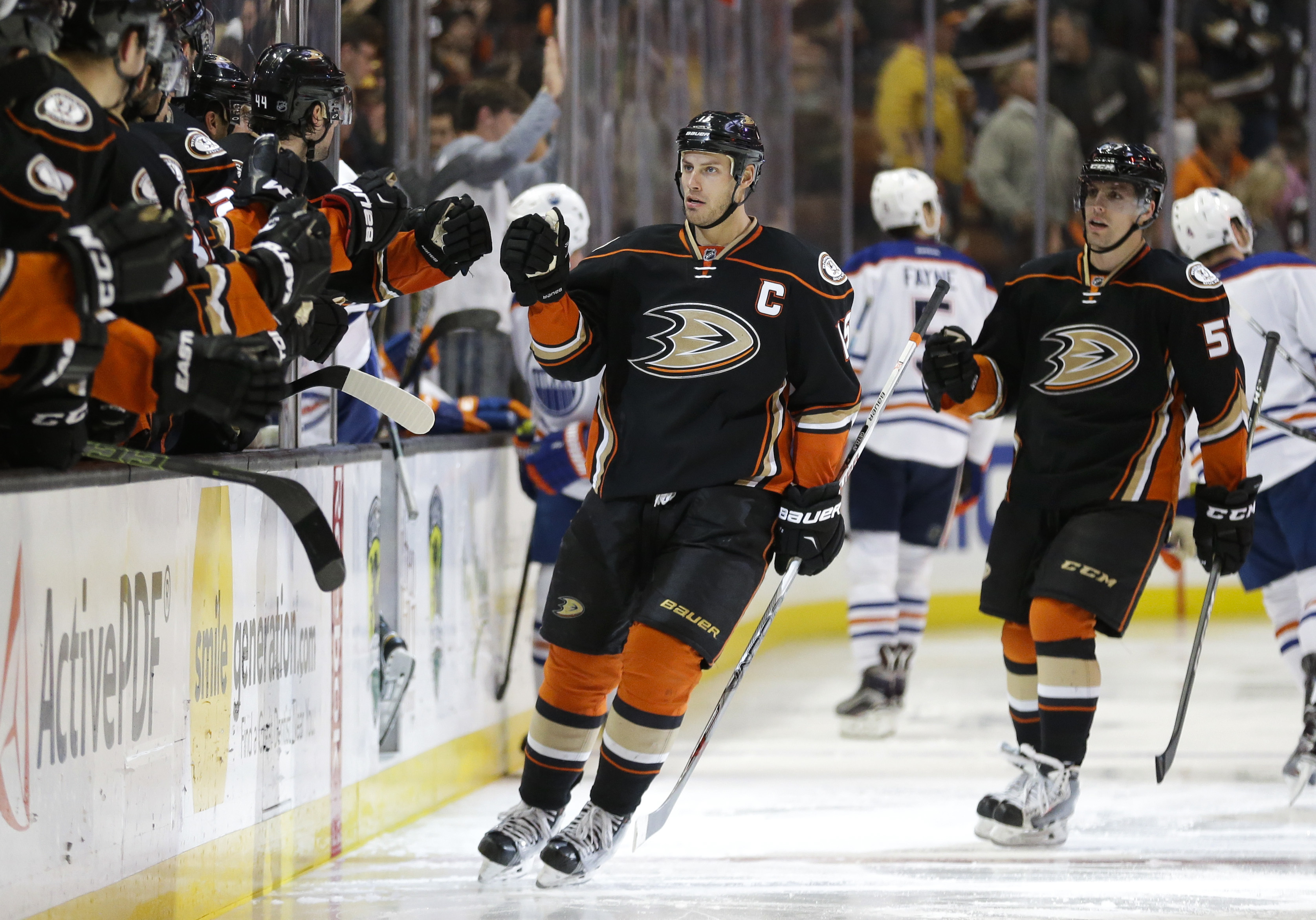 Anaheim Ducks' Ryan Getzlaf, center, celebrates his goal with teammates during the third period of an NHL hockey game against the Edmonton Oilers on Friday, Feb. 26, 2016, in Anaheim, Calif. The Ducks won 2-1 in overtime. (AP Photo/Jae C. Hong)