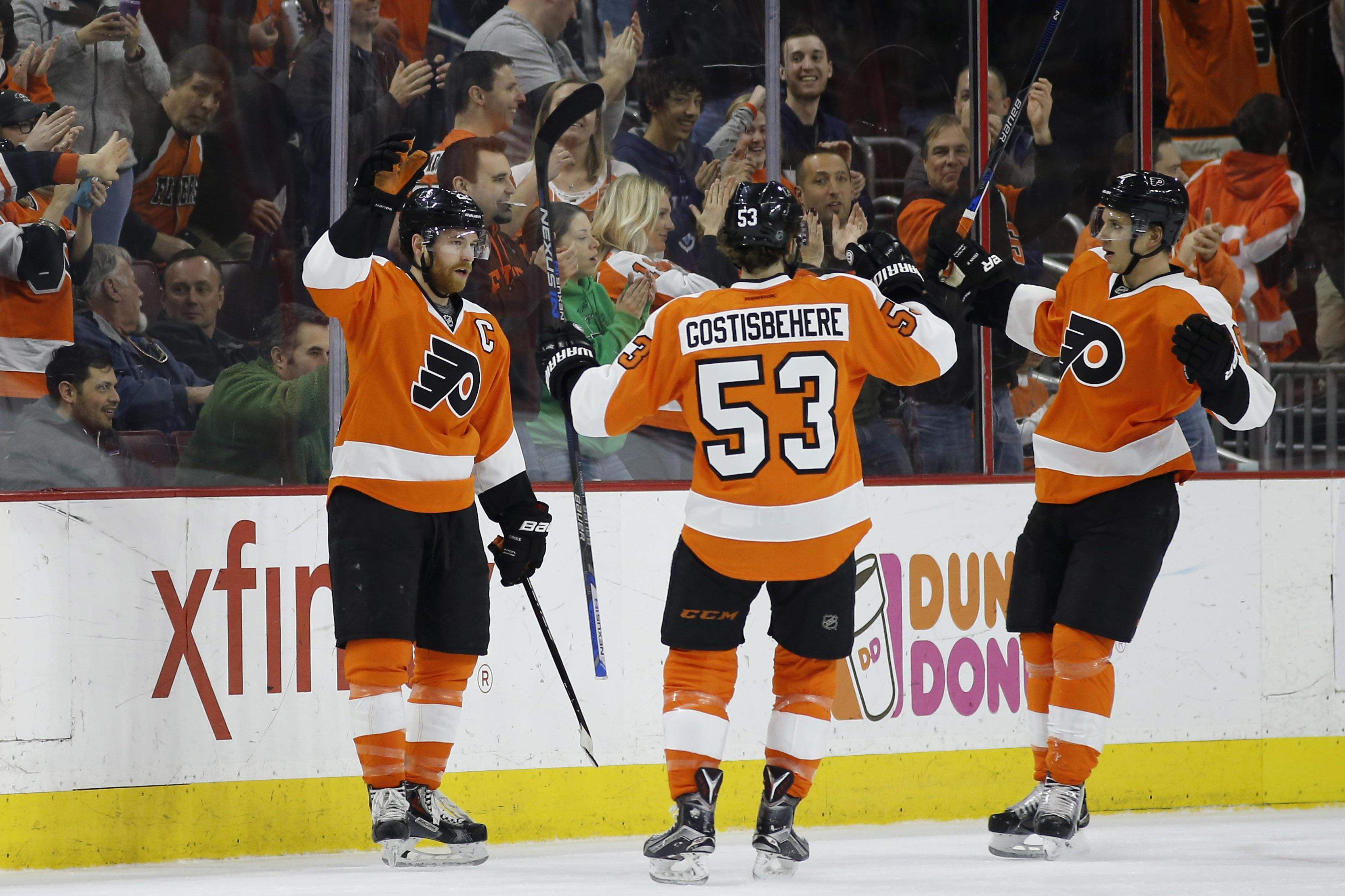 Philadelphia Flyers' Claude Giroux, left, Shayne Gostisbehere and Brayden Schenn celebrate after Giroux's goal during the first period of an NHL hockey game against the Arizona Coyotes, Saturday, Feb. 27, 2016, in Philadelphia. Philadelphia won 4-2. (AP P