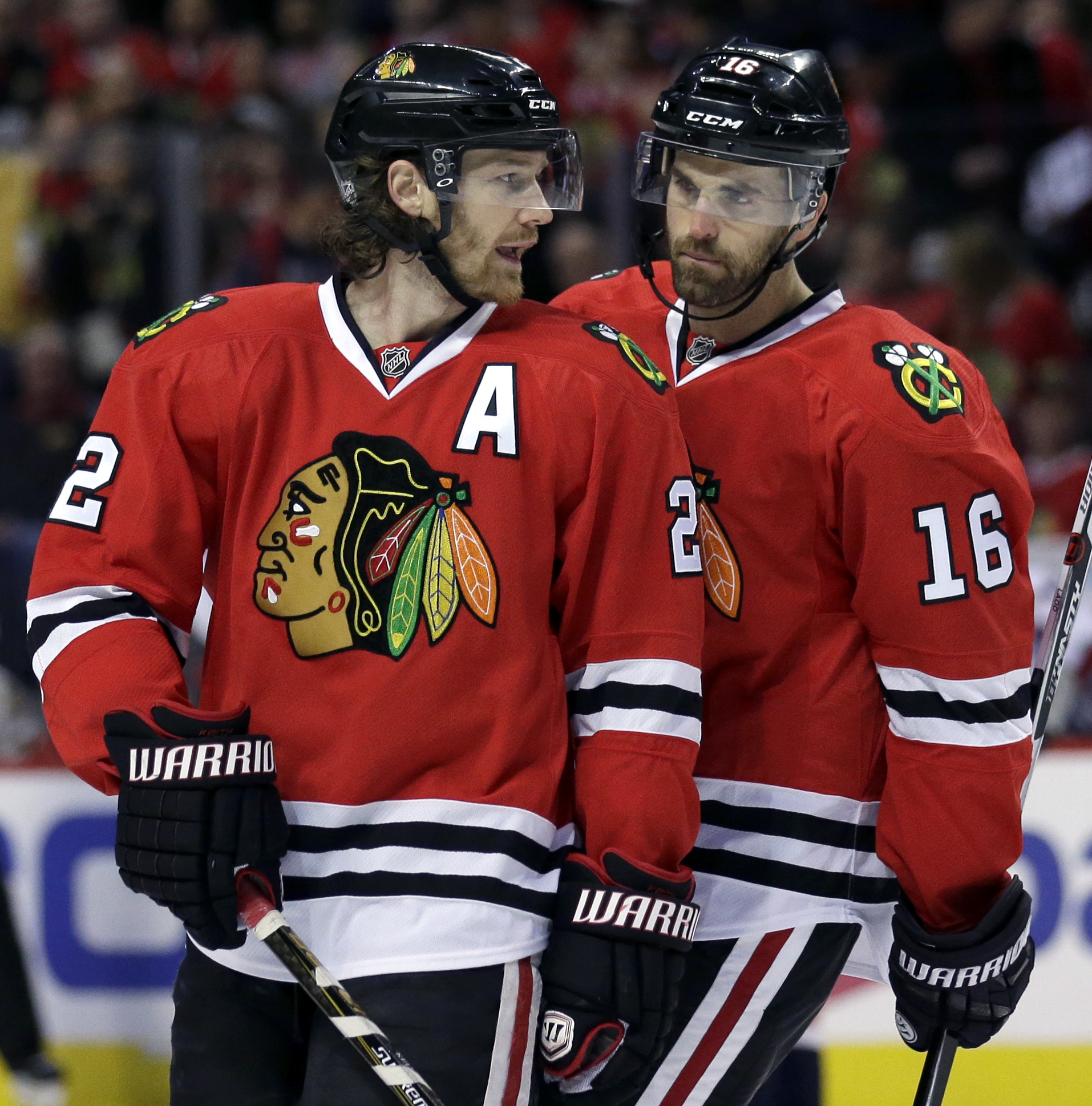 Chicago Blackhawks defenseman Duncan Keith, left, talks with left wing Andrew Ladd during the first period of an NHL hockey game against the Washington Capitals Sunday,Feb. 28, 2016, in Chicago. (AP Photo/Nam Y. Huh)