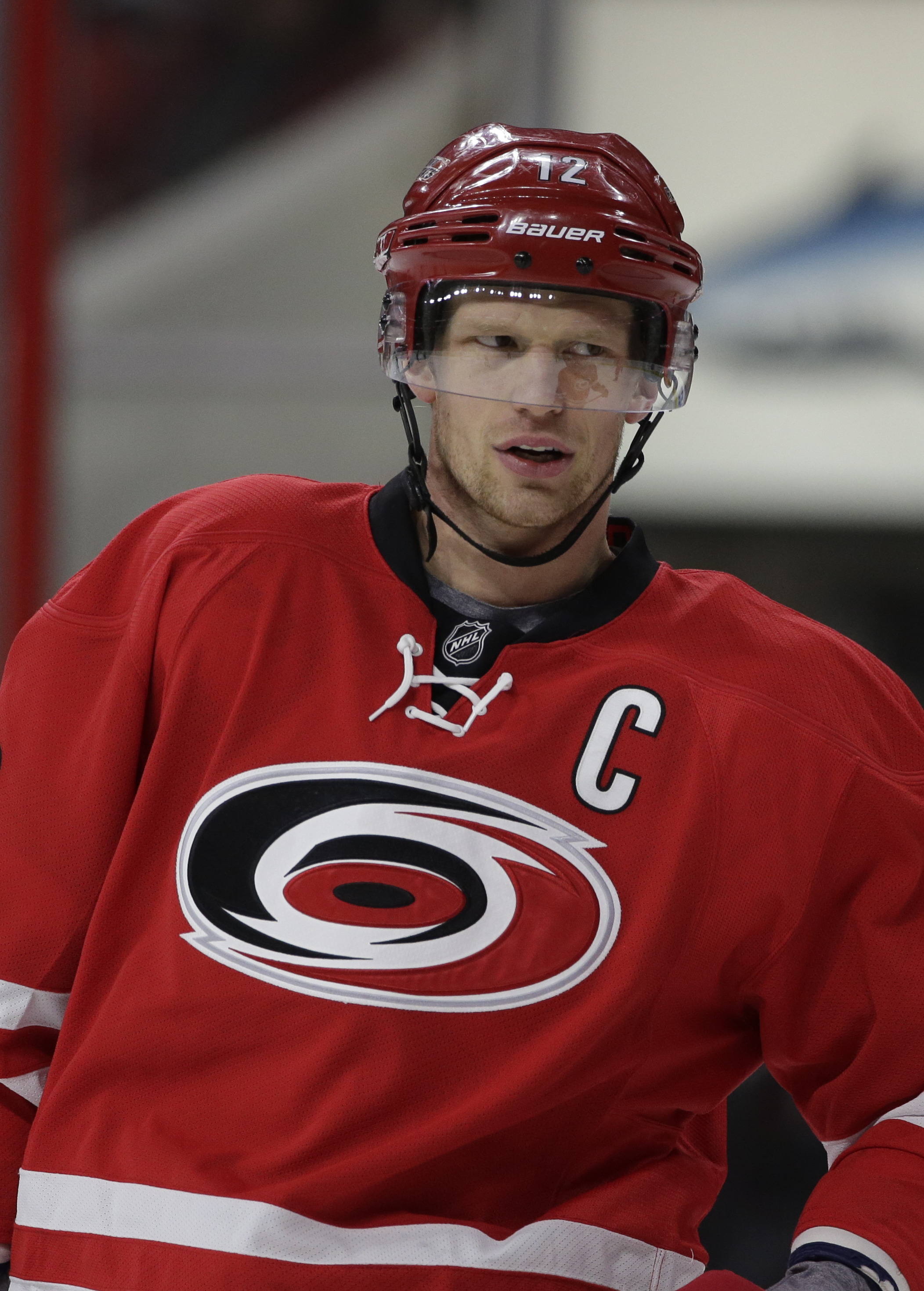 Carolina Hurricanes' Eric Staal (12) waits to go into the game during the first period of an NHL hockey game against the Boston Bruins  in Raleigh, N.C., Friday, Feb. 26, 2016. (AP Photo/Gerry Broome)