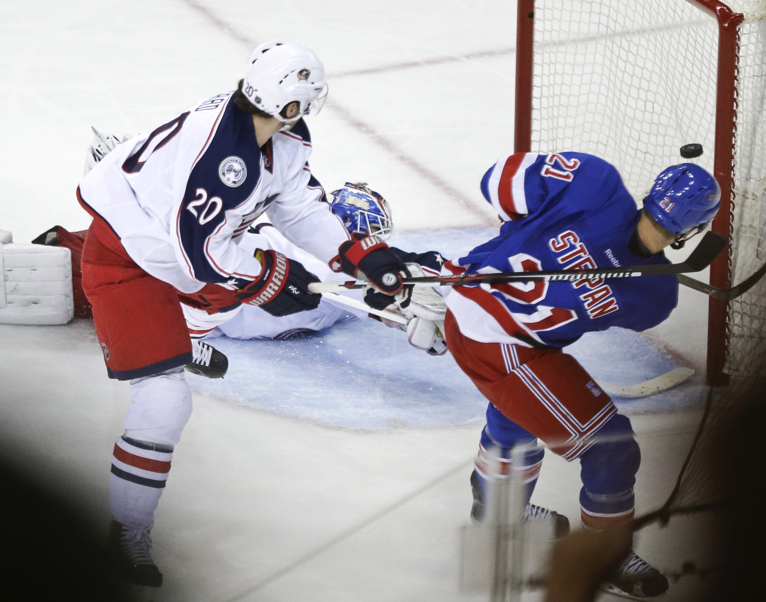 New York Rangers' Derek Stepan (21) shoots the puck past Columbus Blue Jackets goalie Joonas Korpisalo to score the game winning goal during the third period of an NHL hockey game Monday, Feb. 29, 2016, in New York. The Rangers won 2-1.(AP Photo/Frank Fra
