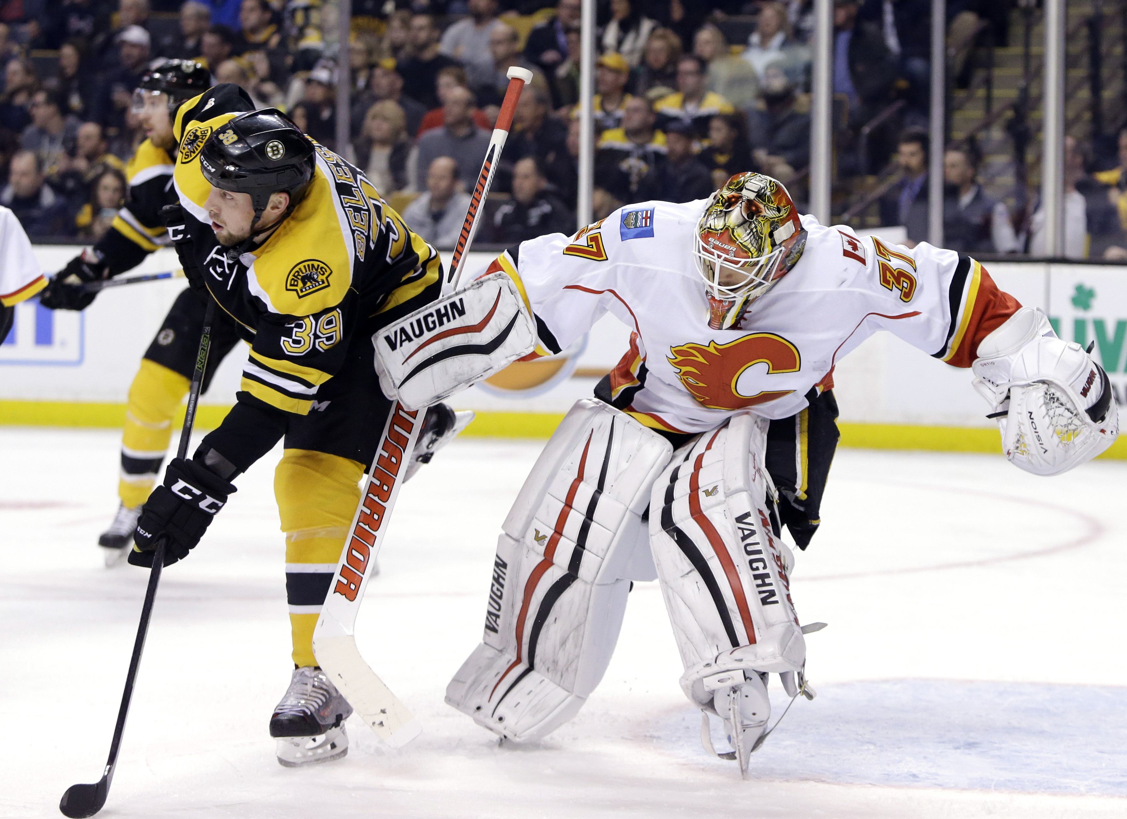 Boston Bruins left wing Matt Beleskey (39) makes contact with Calgary Flames goalie Joni Ortio (37) in the second period of an NHL hockey game, Tuesday, March 1, 2016, in Boston. Beleskey was called for goaltender interference. (AP Photo/Elise Amendola)
