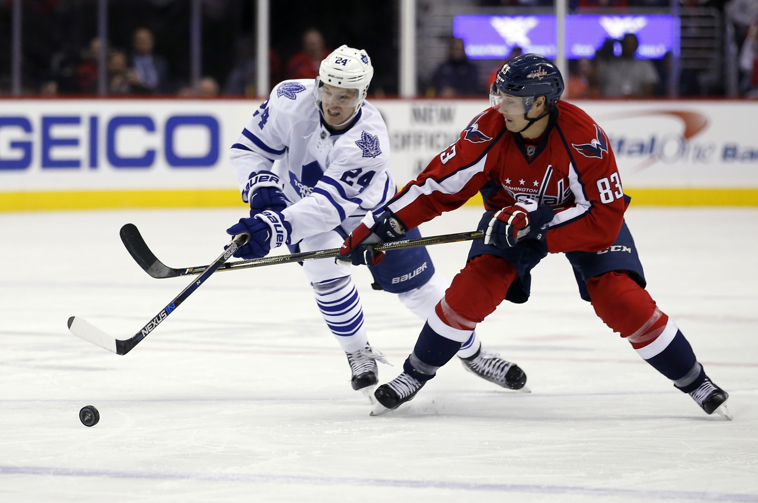 Toronto Maple Leafs center Peter Holland (24) and Washington Capitals center Jay Beagle (83) battle for the puck in the second period of an NHL hockey game, Wednesday, March 2, 2016, in Washington. (AP Photo/Alex Brandon)