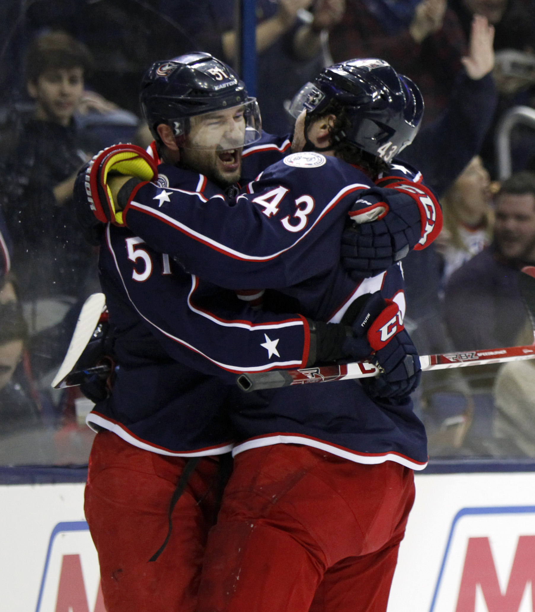 Columbus Blue Jackets' Fedor Tyutin, left, of Russia, celebrates his goal against the Edmonton Oilers with teammate Scott Hartnell during the second period of an NHL hockey game in Columbus, Ohio, Friday, March 4, 2016. (AP Photo/Paul Vernon)