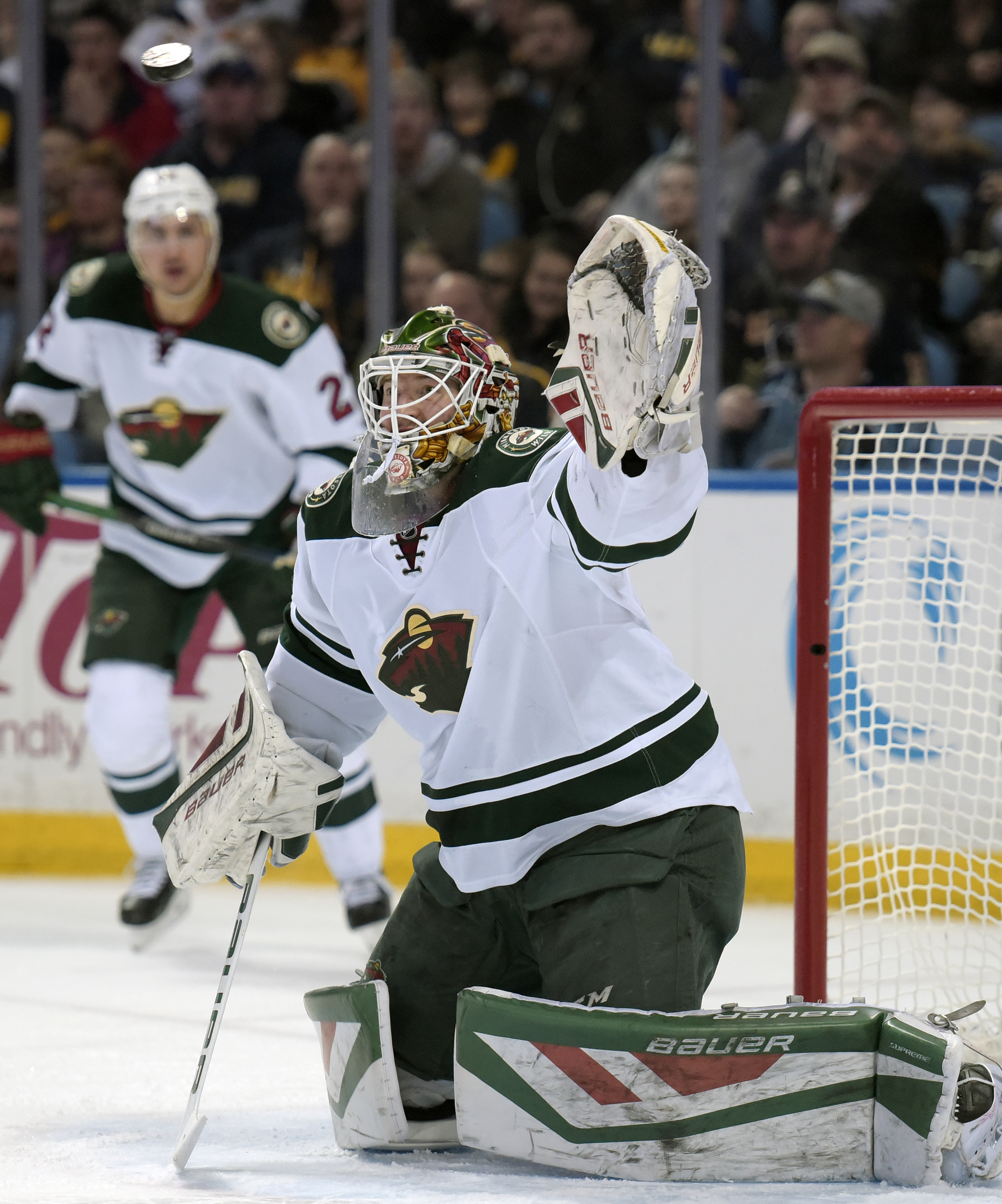 Minnesota Wild goaltender Devan Dubnyk eyes the puck during the first period of an NHL hockey game against the Buffalo Sabres, Saturday, March 5, 2016, in Buffalo, N.Y. (AP Photo/Gary Wiepert)