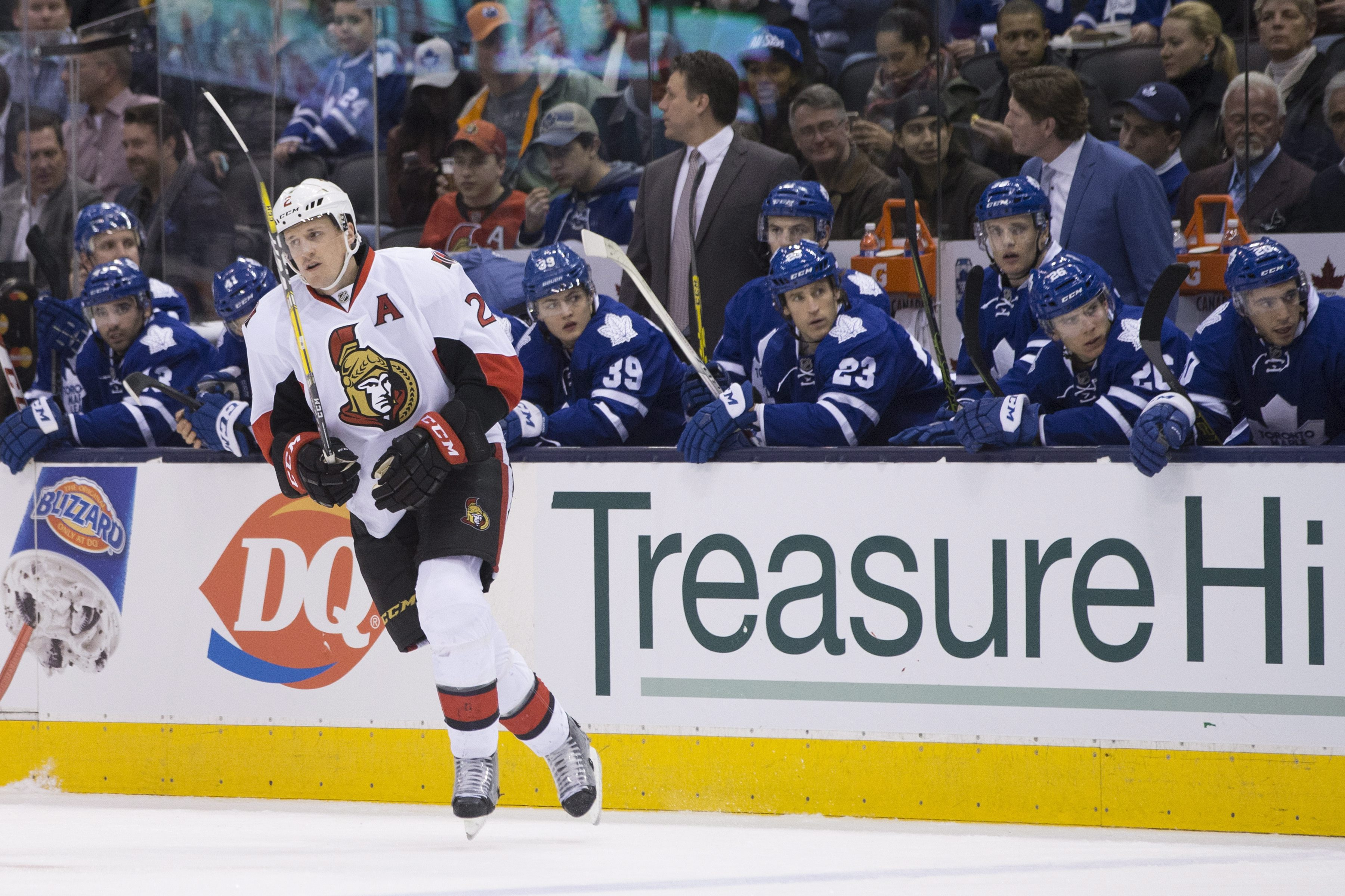 Ottawa Senators' Dion Phaneuf skates pass the Toronto Maple Leafs bench during first-period NHL hockey game action in Toronto, Saturday, March 5, 2016. (Chris Young/The Canadian Press via AP) MANDATORY CREDIT