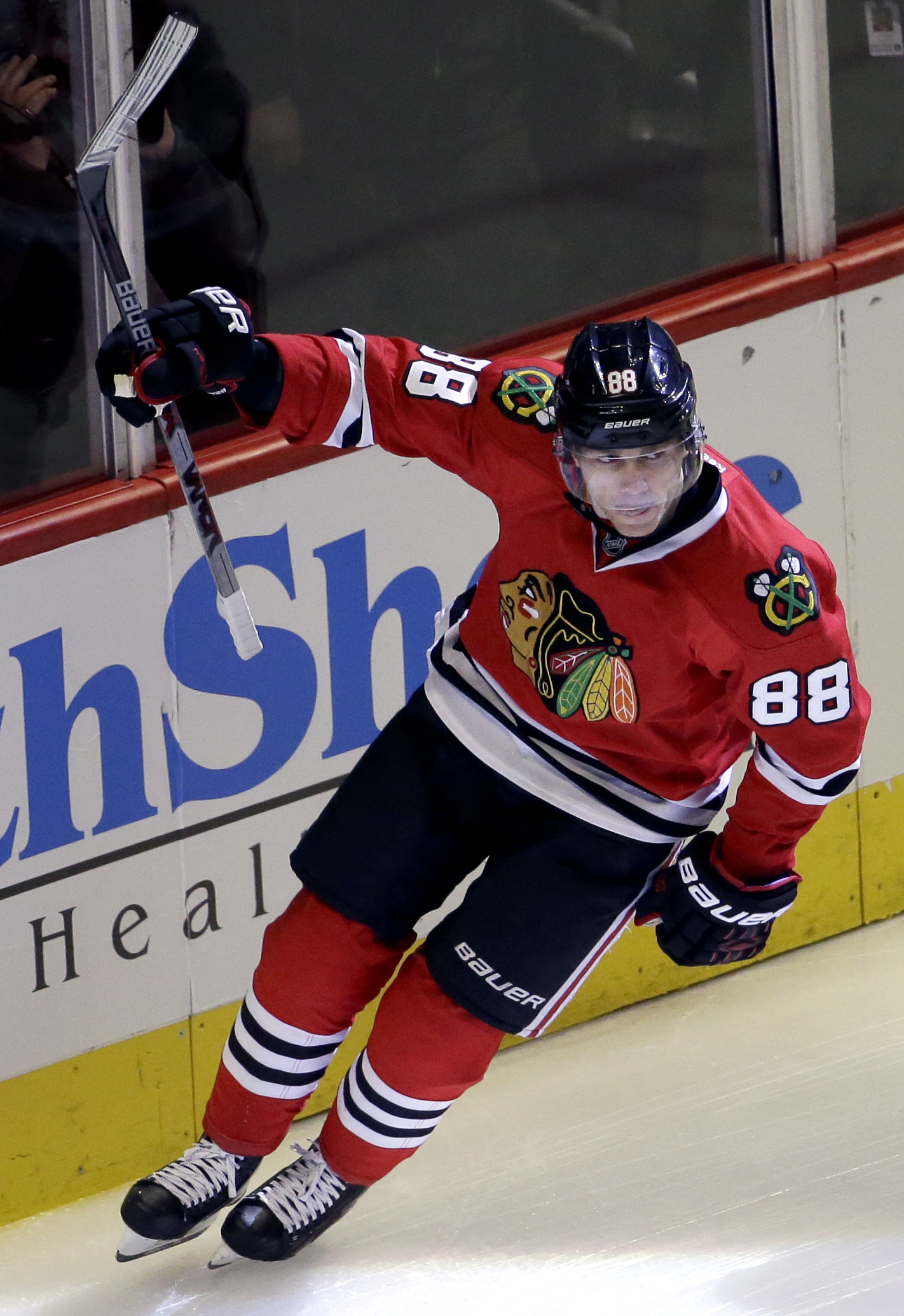 Chicago Blackhawks right wing Patrick Kane celebrates after scoring his goal during the first period of an NHL hockey game against the Detroit Red Wings Sunday, March 6, 2016, in Chicago. (AP Photo/Nam Y. Huh)