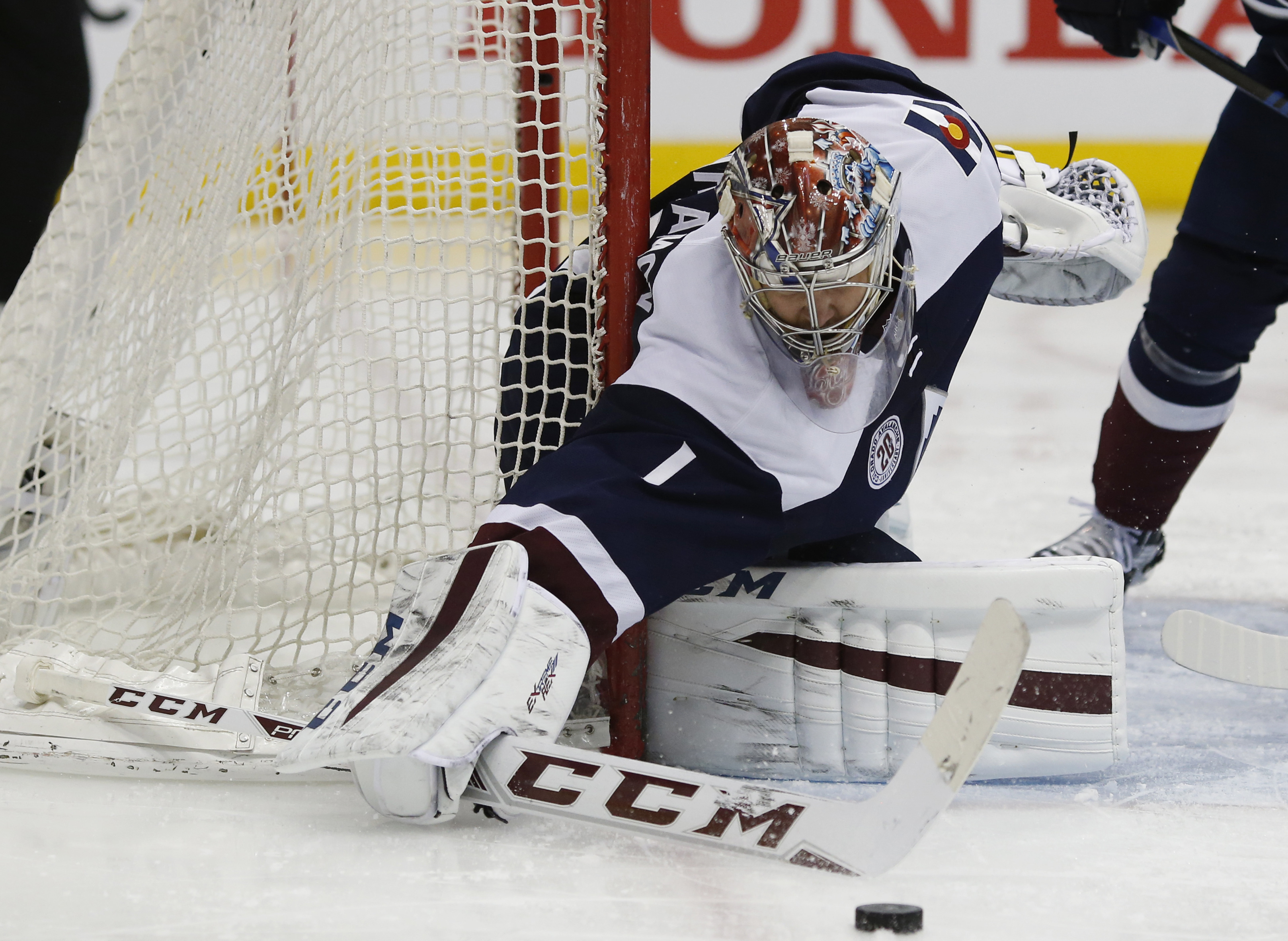 Colorado Avalanche goalie Semyon Varlamov, of Russia, makes a stick save of a shot against the Arizona Coyotes in the second period of an NHL hockey game Monday, March 7, 2016, in downtown Denver. (AP Photo/David Zalubowski)
