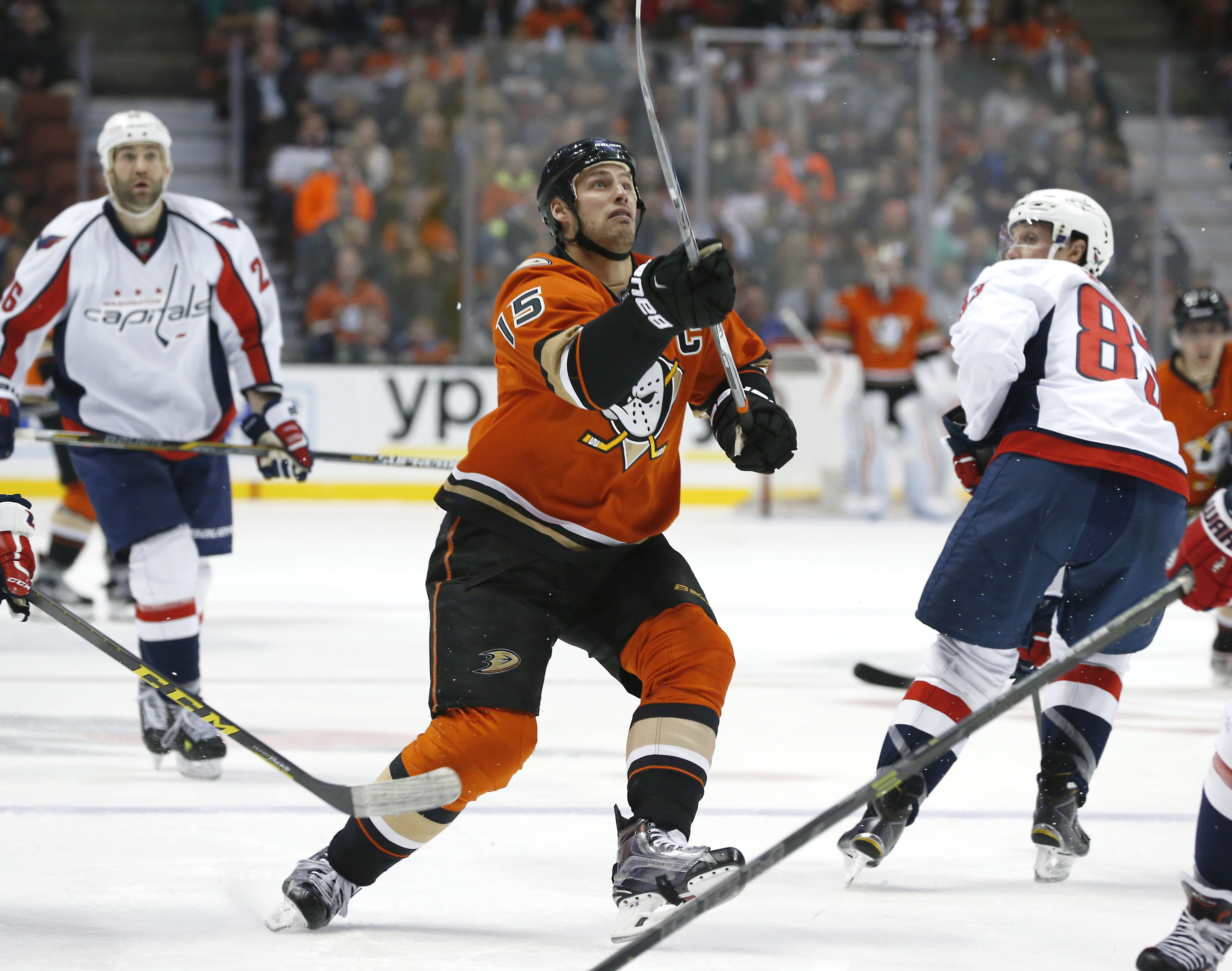 Anaheim Ducks' Ryan Getzlaf (15) reaches for the puck as Washington Capitals center Jay Beagle, right, looks on in the second period of an NHL hockey game in Anaheim, Calif., Monday, March 7, 2016. (AP Photo/Christine Cotter)