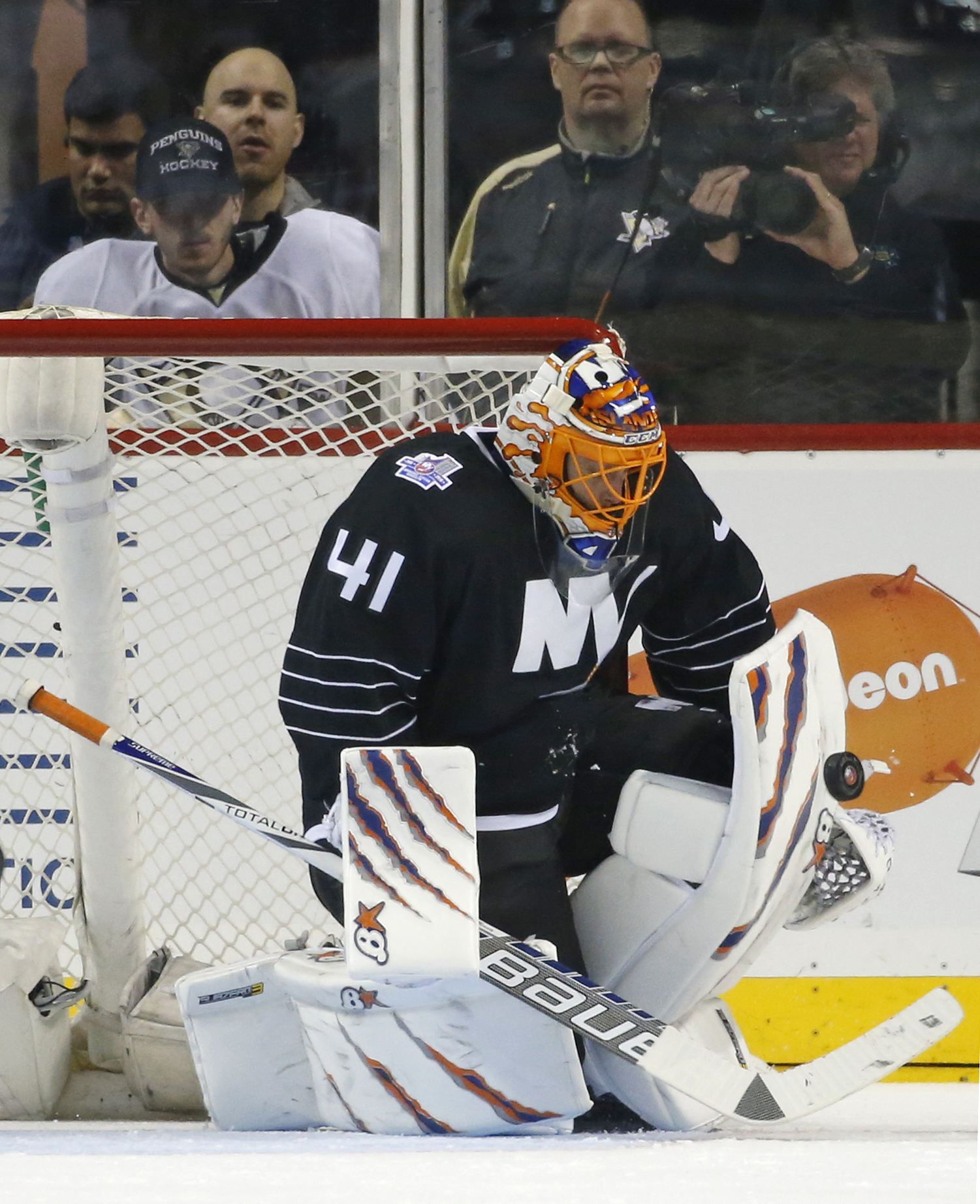 New York Islanders goalie Jaroslav Halak makes a save during the second period of an NHL hockey game against the Pittsburgh Penguins in New York, Tuesday, March 8, 2016. (AP Photo/Kathy Willens)