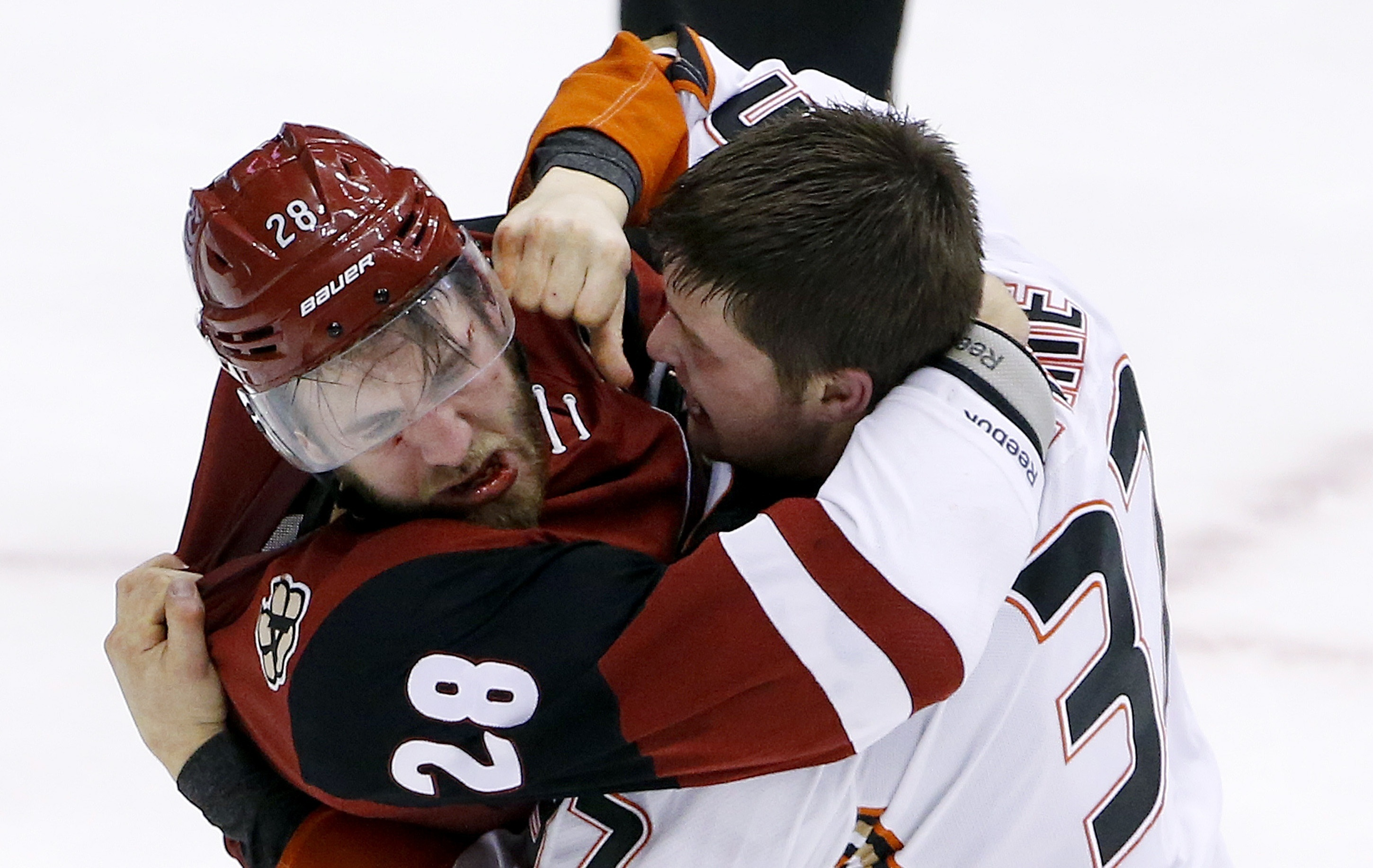 FILE - In this March 3, 2016, file photo, Anaheim Ducks' Nick Ritchie, right, fights with Arizona Coyotes' Jarred Tinordi (28) during the third period of an NHL hockey game in Glendale, Ariz. Tinordi has been suspended for 20 games without pay for violati