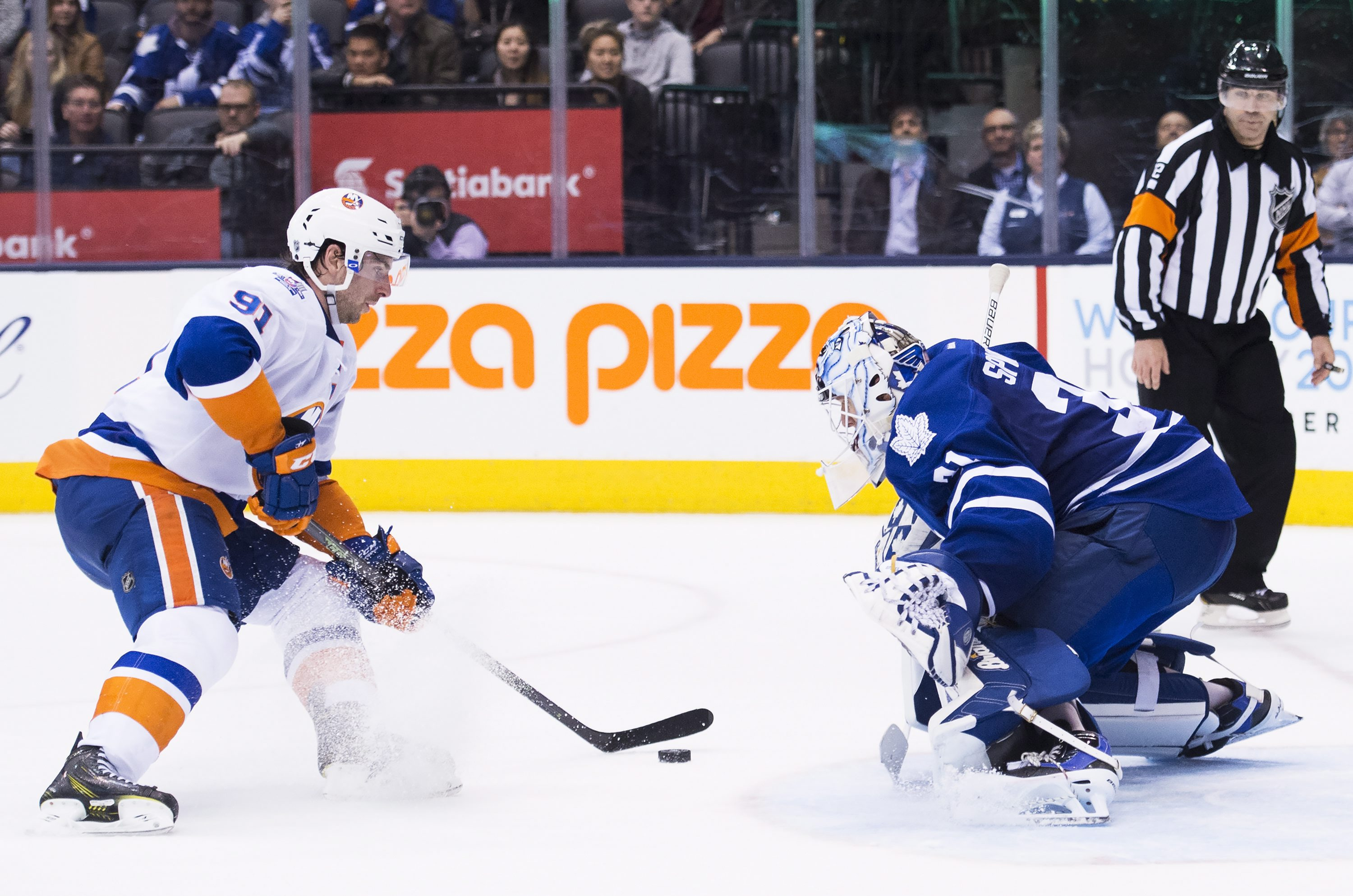 Toronto Maple Leafs goalie Garret Sparks (31) stops New York Islanders center John Tavares (91) in a shoot out during an NHL hockey game in Toronto, Wednesday, March 9, 2016. (Nathan Denette/The Canadian Press via AP) MANDATORY CREDIT