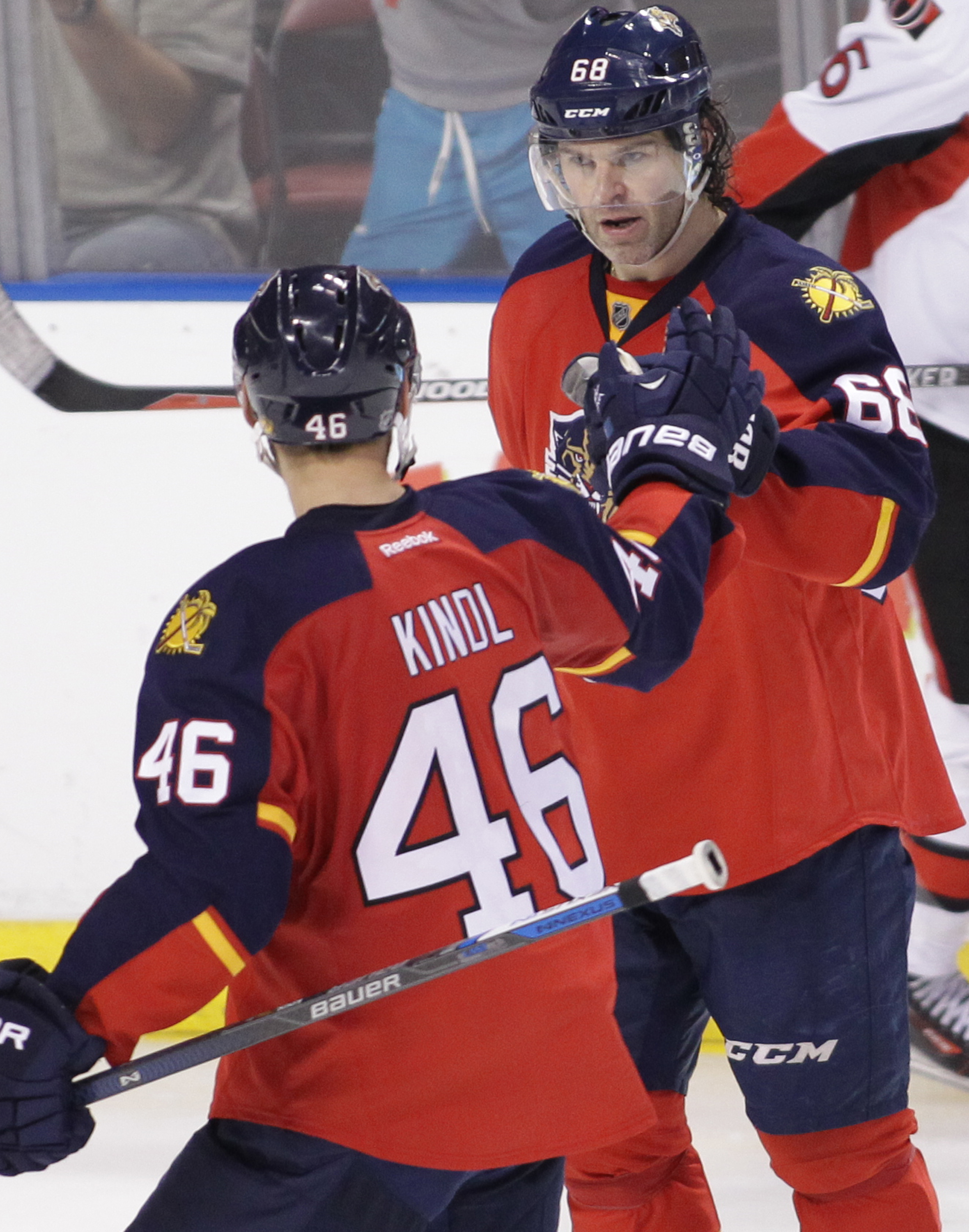 Florida Panthers' Jaromir Jagr, right, celebrates with teammate Jakub Kindl (46), of the Czech Republic, after scoring a goal during the third period of an NHL hockey game against the Ottawa Senators, Thursday, March 10, 2016 in Sunrise, Fla. The Panthers