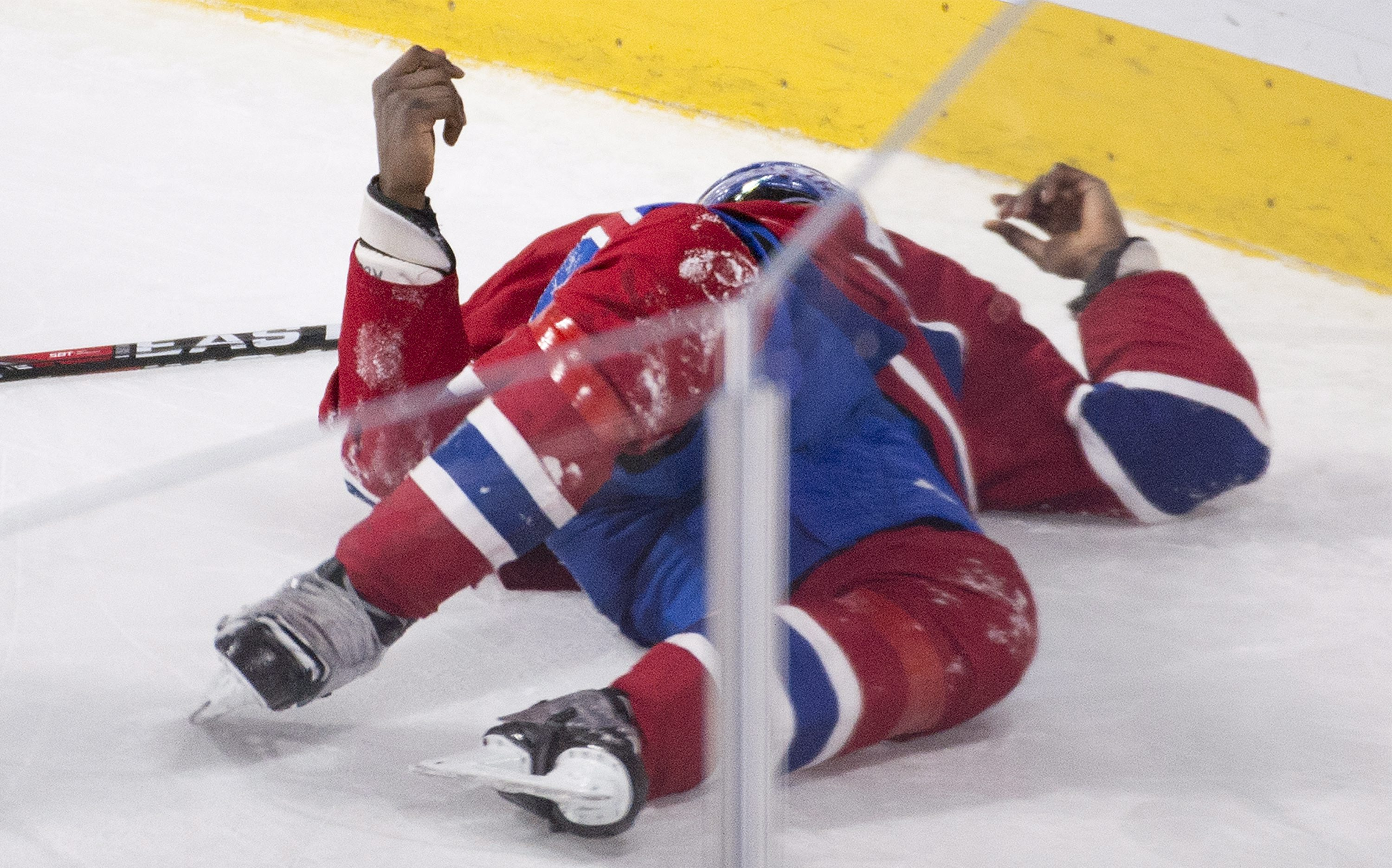 Montreal Canadiens' P.K. Subban lies injured on the ice during during the third period of an NHL hockey game against the Buffalo Sabres on Thursday, March 10, 2016, in Montreal. (Graham Hughes/The Canadian Press via AP)