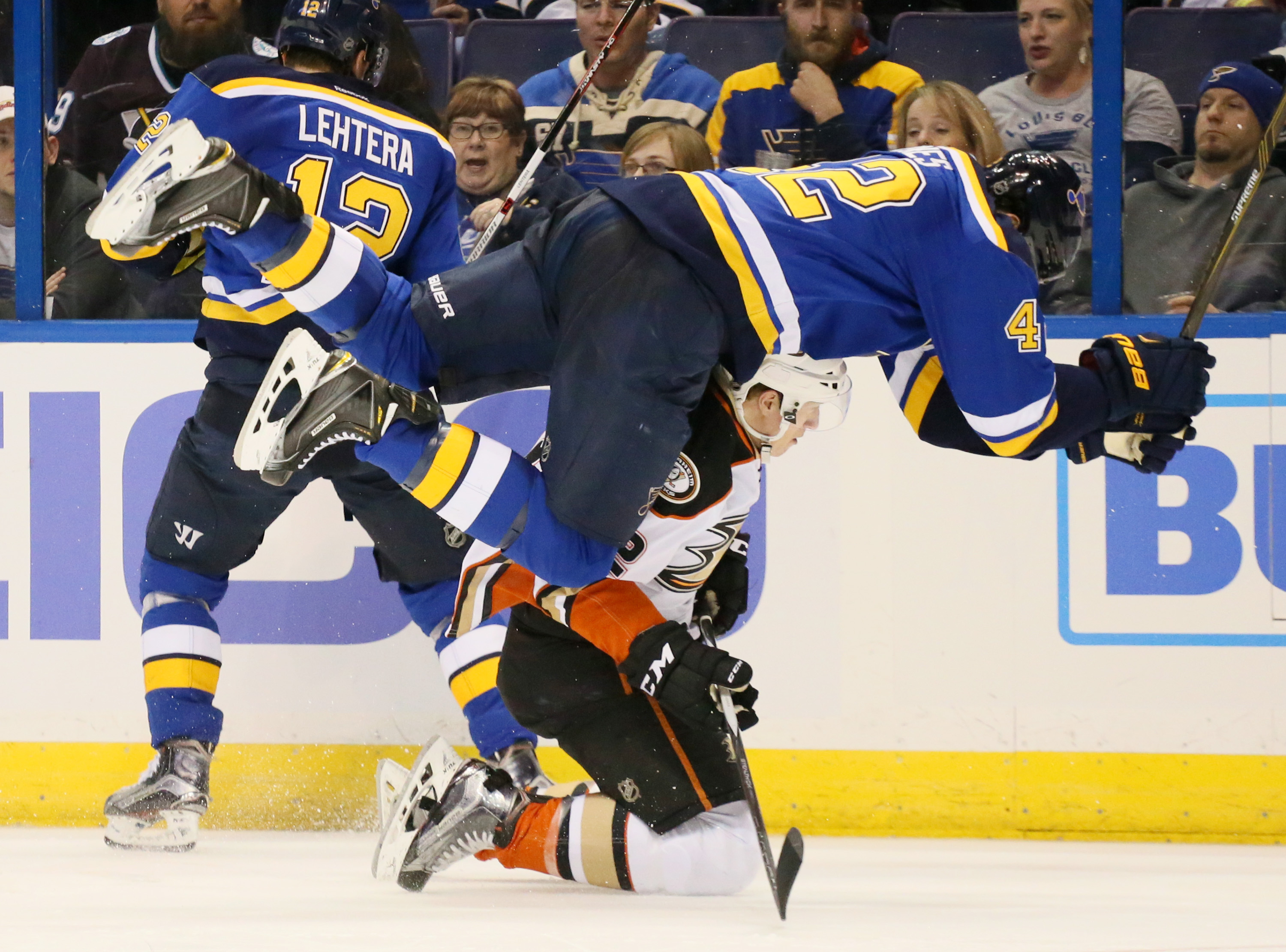 St. Louis Blues center David Backes, top, tumbles over Anaheim Ducks defenseman Josh Manson in the third period of an NHL hockey game Friday, March 11, 2016, in St. Louis. (Chris Lee/St. Louis Post-Dispatch via AP)  EDWARDSVILLE INTELLIGENCER OUT; THE ALT