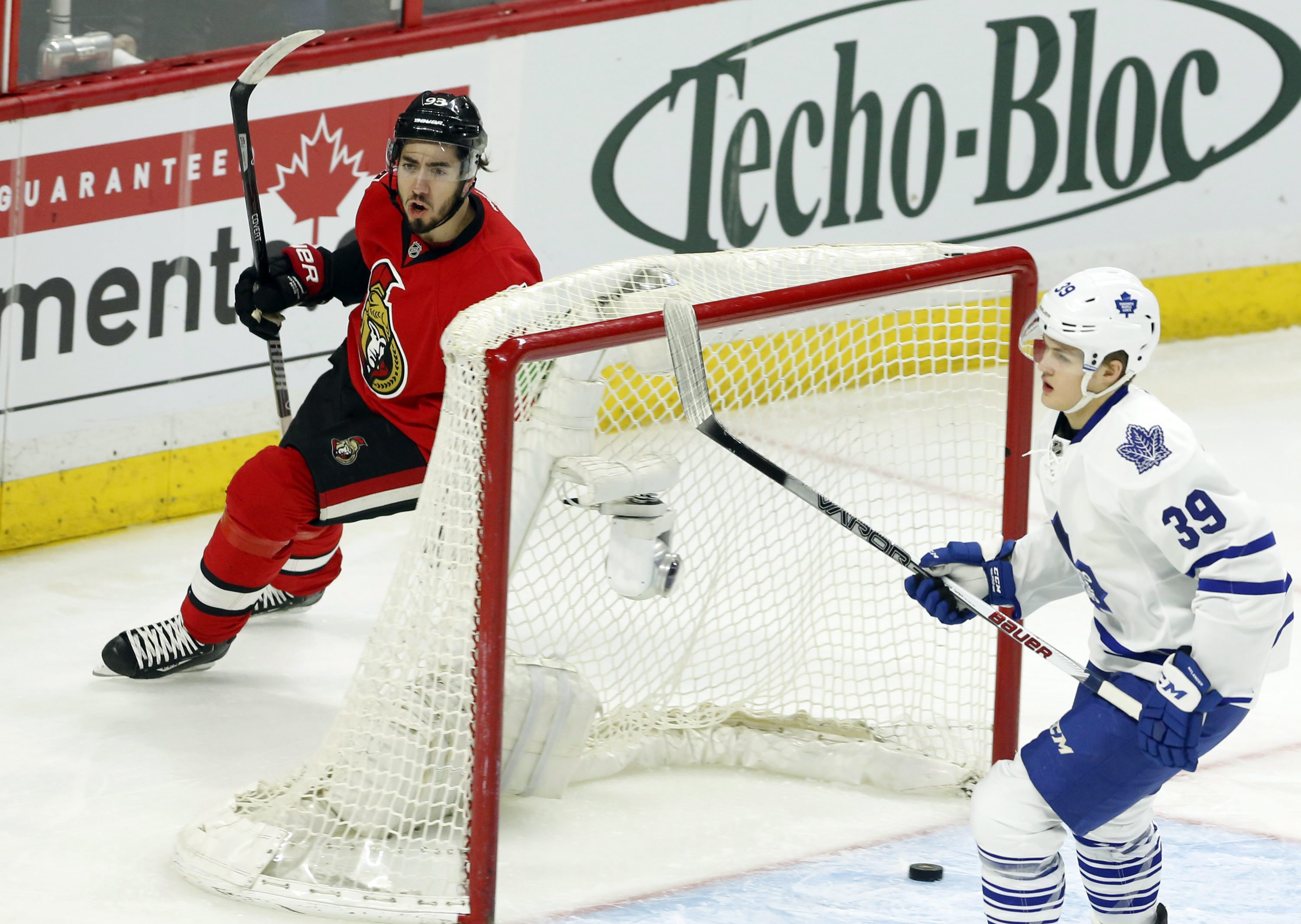 Ottawa Senators' Mika Zibanejad (93) celebrates his goal as Toronto Maple Leafs' William Nylander (39) looks on during the first period of an NHL hockey gane in Ottawa, Ontario, Saturday, March 12, 2016. (Fred Chartrand/The Canadian Press via AP) MANDATOR