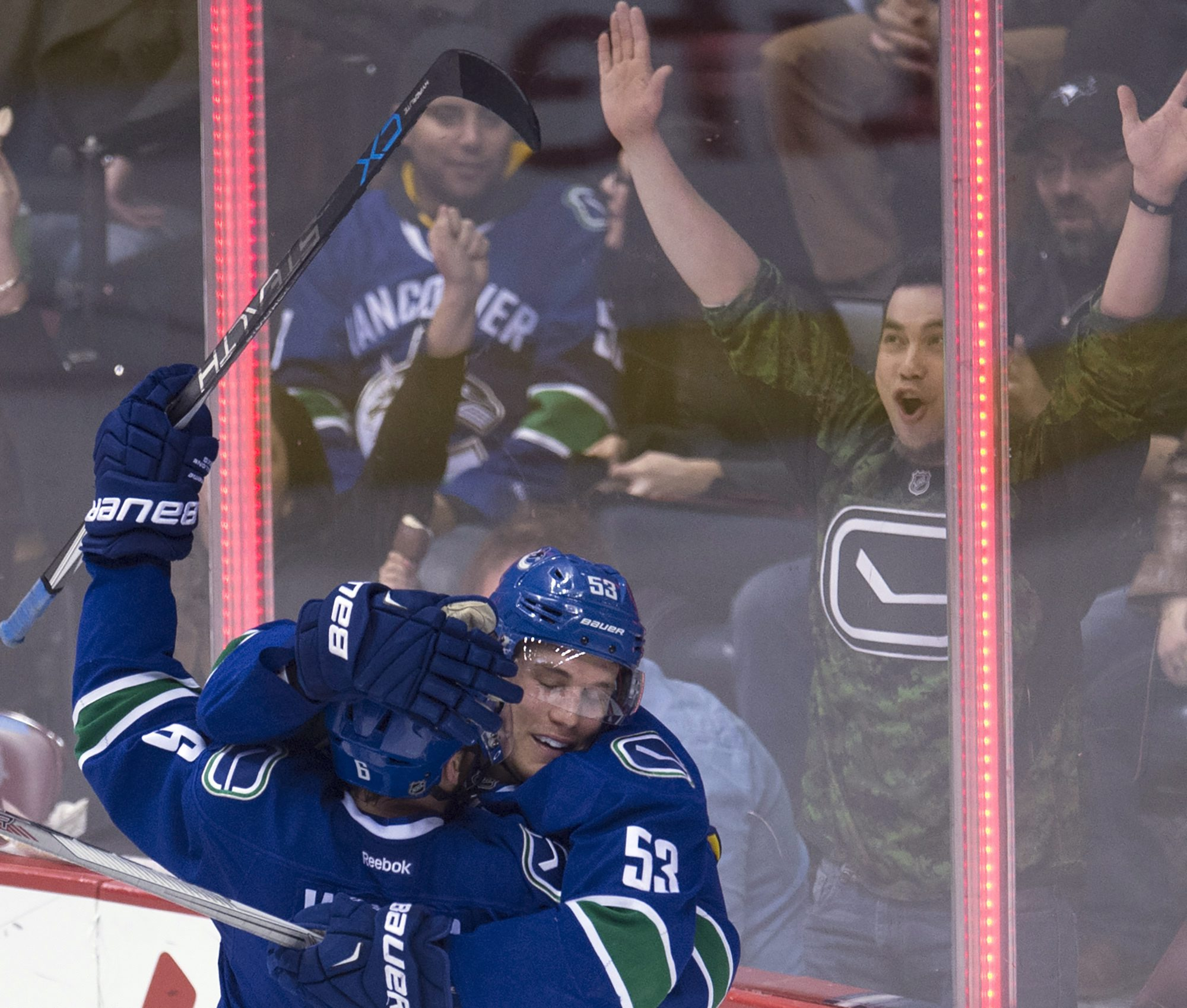 Vancouver Canucks center  Bo Horvat (53) celebrates his goal against the Nashville Predators with teammate Yannick Weber (6) during the second period of an NHL hockey game Saturday, March 12, 2016, in Vancouver, British Columbia. (Jonathan Hayward/The Can