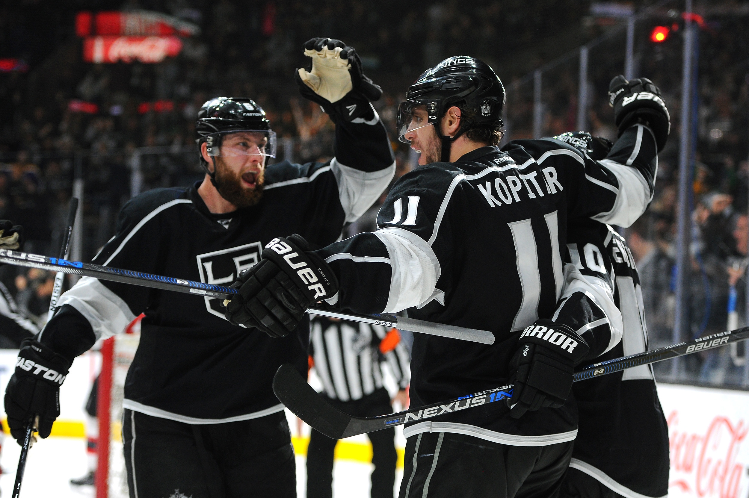 The Los Angeles Kings' Anze Kopitar (11) is congratulated by teammates after scoring against New Jersey Devils during the second period of an NHL hockey game in Los Angeles, Saturday, March 12, 2016. (AP Photo/Michael Owen Baker)