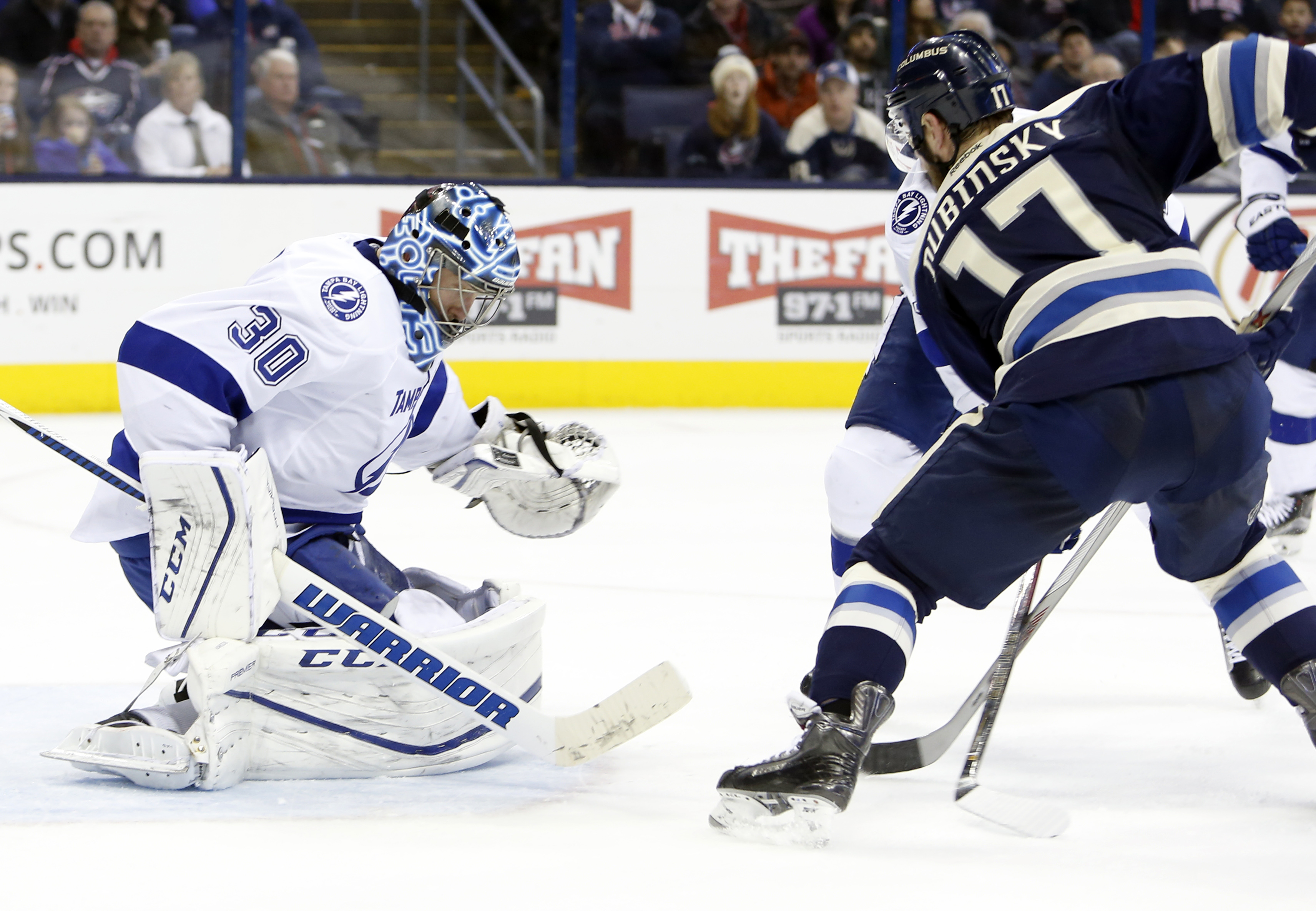 Tampa Bay Lightning's Ben Bishop, left, makes a save against Columbus Blue Jackets' Brandon Dubinsky during the second period of an NHL hockey game Sunday, March 13, 2016, in Columbus, Ohio. (AP Photo/Jay LaPrete)