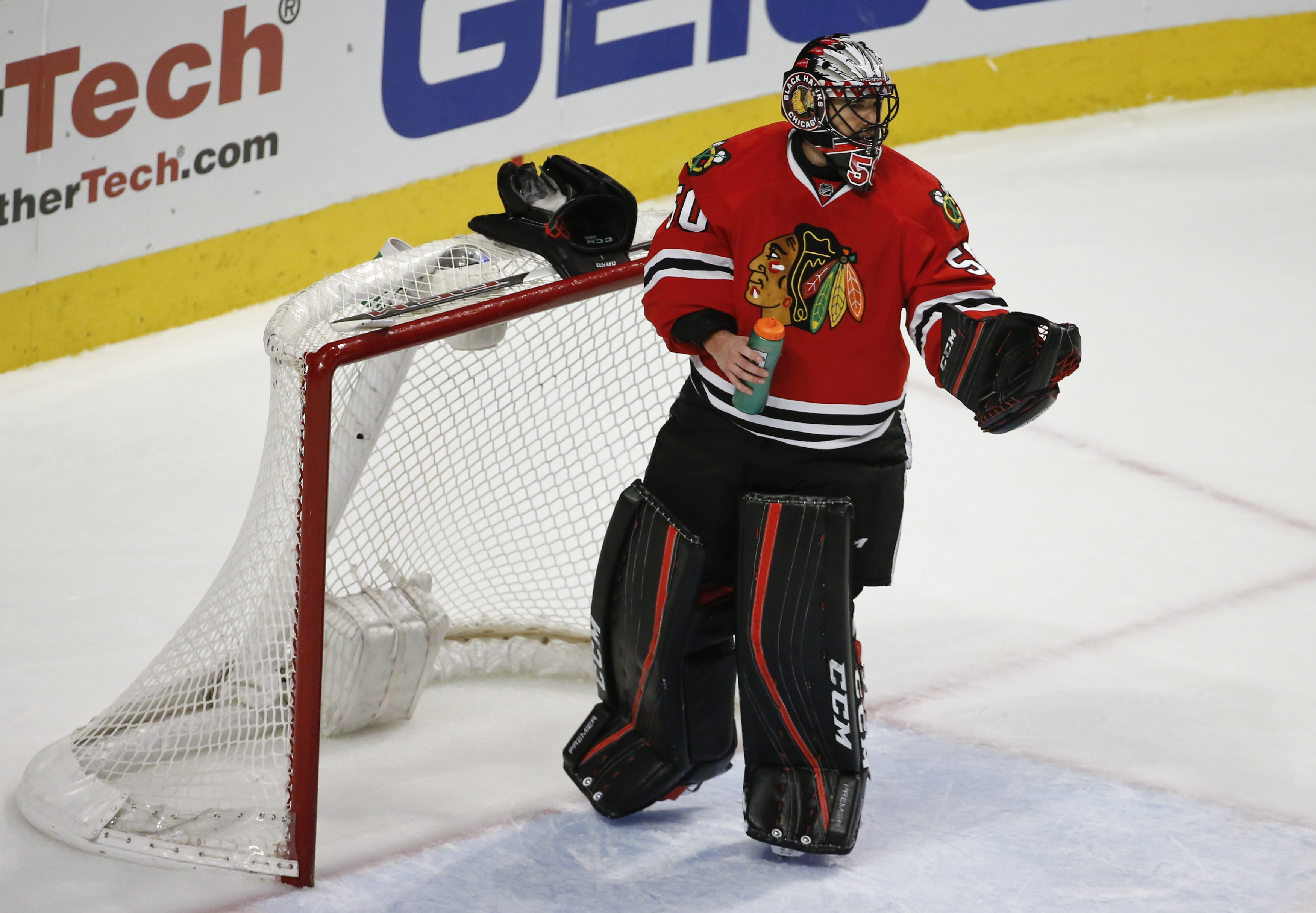 Chicago Blackhawks goalie Corey Crawford (50) reacts after allowing a goal scored by Los Angeles Kings center Vincent Lecavalier during the second period of an NHL hockey game Monday, March 14, 2016, in Chicago. (AP Photo/Kamil Krzaczynski)
