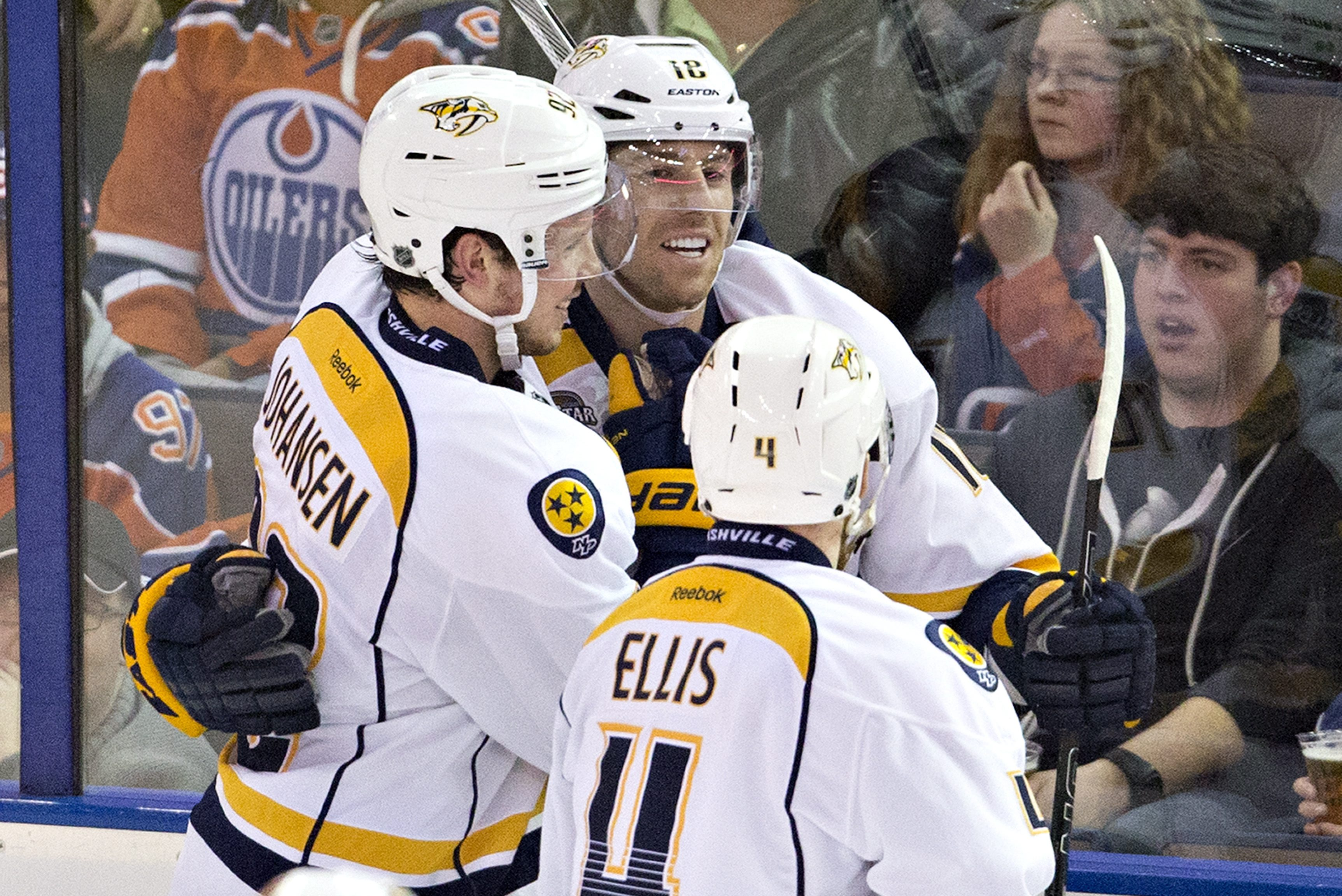 Nashville Predators' Ryan Johansen (92), James Neal (18) and Ryan Ellis (4) celebrate a goal against the Edmonton Oilers during the third period of an NHL hockey game in Edmonton, Alberta, Monday March 14, 2016. (Jason Franson/The Canadian Press via AP) M