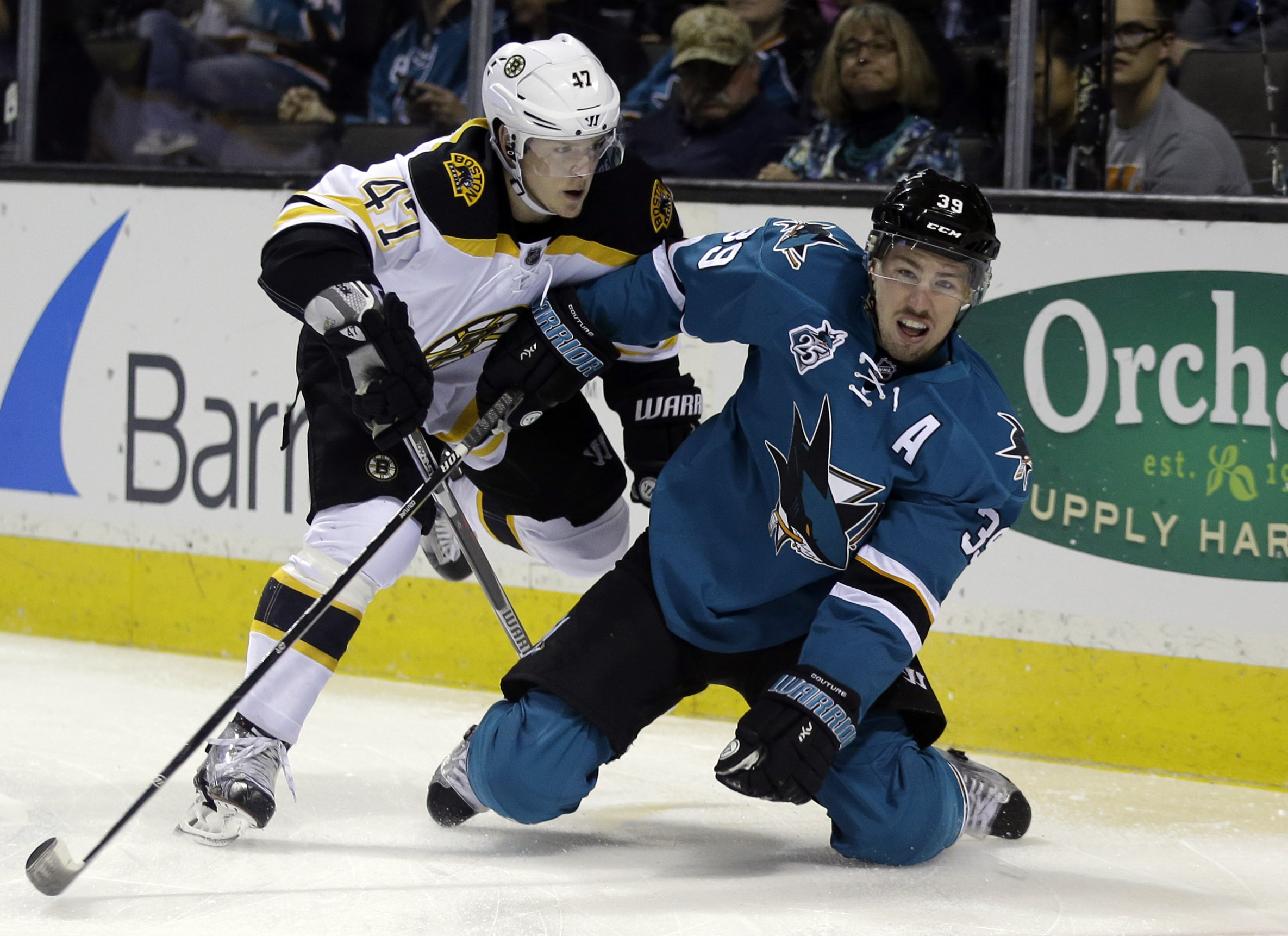 San Jose Sharks' Logan Couture (39) collides with Boston Bruins defenseman Torey Krug (47) during the first period of an NHL hockey game Tuesday, March 15, 2016, in San Jose, Calif. (AP Photo/Marcio Jose Sanchez)