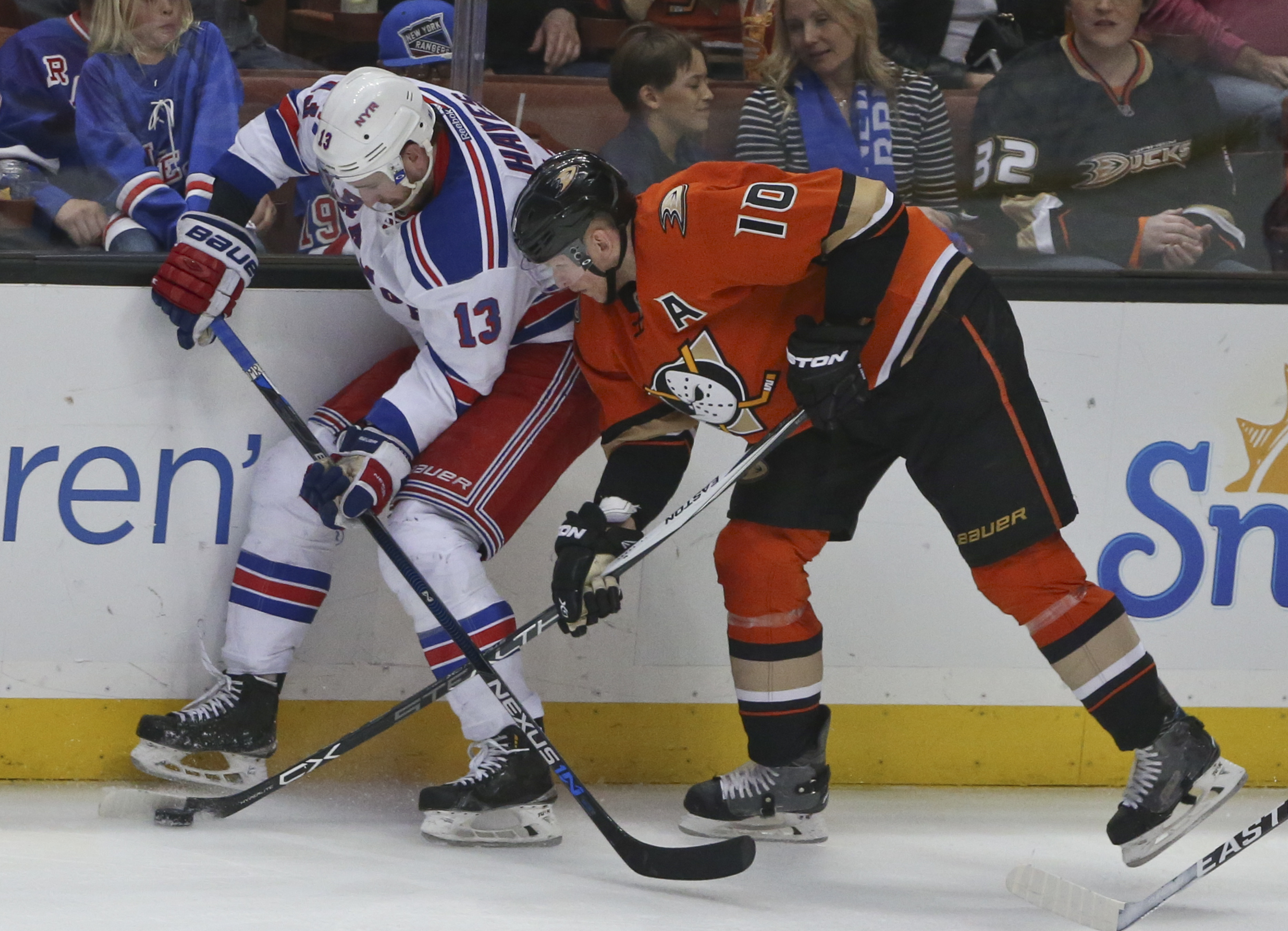 Anaheim Ducks right wing Corey Perry gets inside on New York Rangers right wing Kevin Hayes to free the puck during the second period of an NHL hockey game Wednesday March 16, 2016, in Anaheim, Calif. (AP Photo/Lenny Ignelzi)