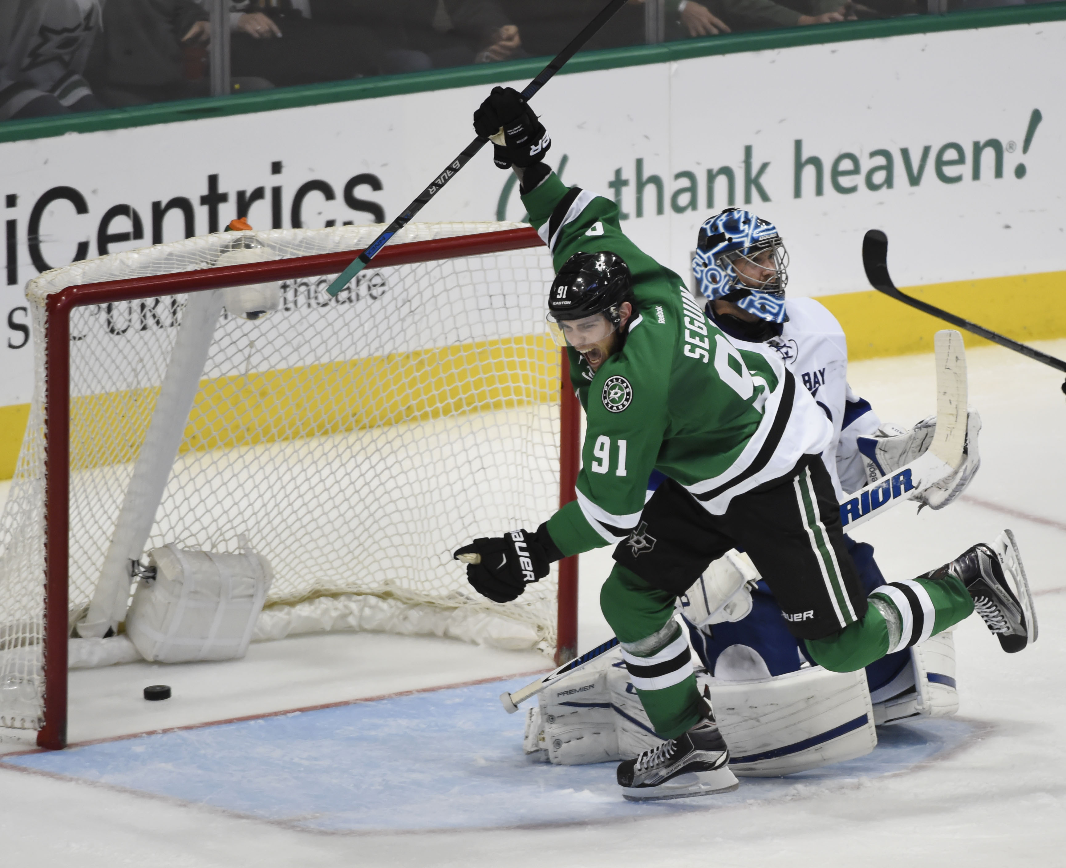 Dallas Stars center Tyler Seguin (91) celebrates a goal by teammate Stephen Johns (28), not pictured, on Tampa Bay Lightning goalie Ben Bishop (30) during the third period of their NHL hockey game in Dallas, on Thursday, March 17, 2016, in Dallas. Dallas