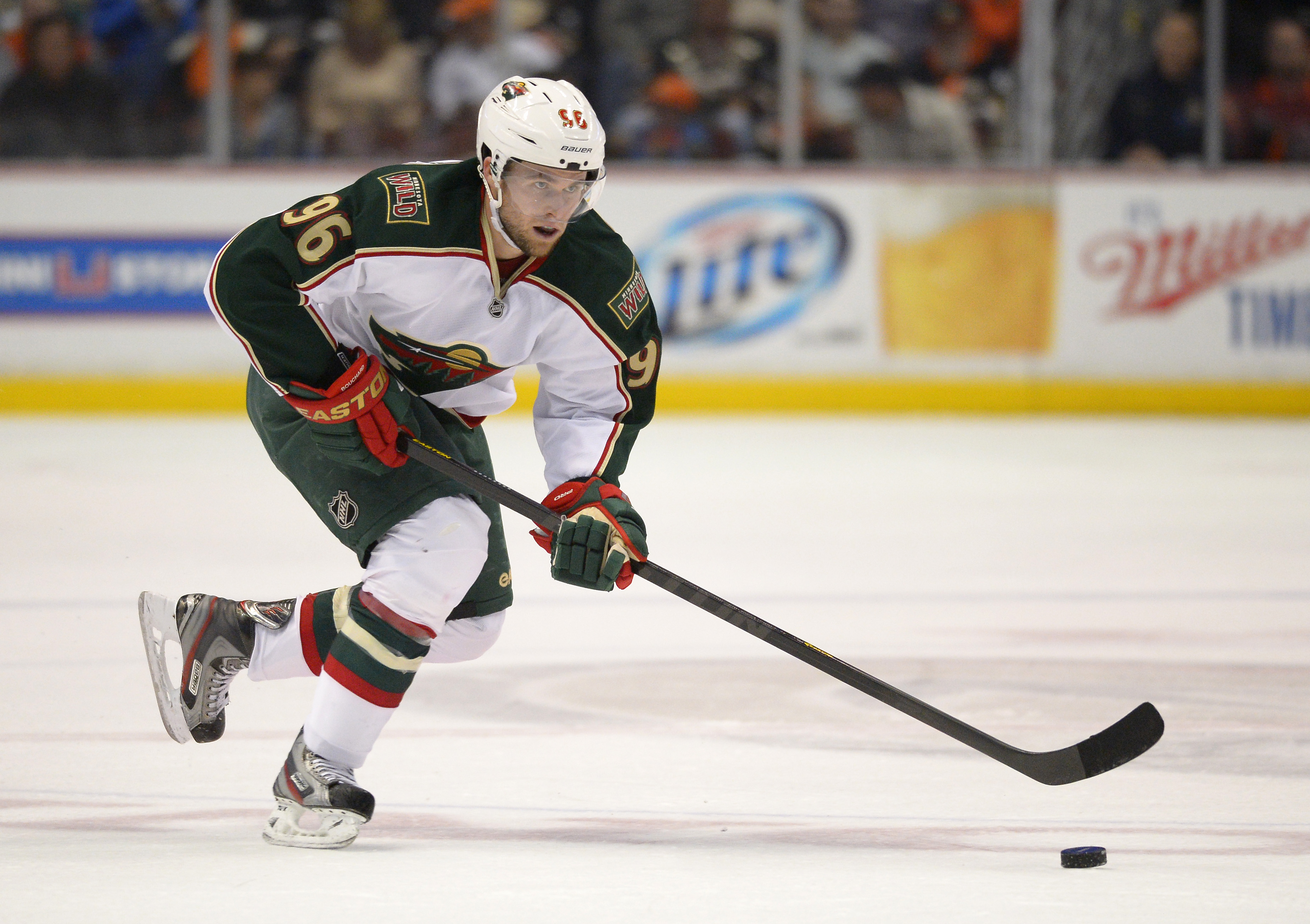 In this Friday, March 1, 2013 photo, Minnesota Wild right wing Pierre-Marc Bouchard skates with the puck during the first period of their game against the Anaheim Ducks in Anaheim. Longtime Minnesota Wild forward Bouchard has announced his retirement, Age