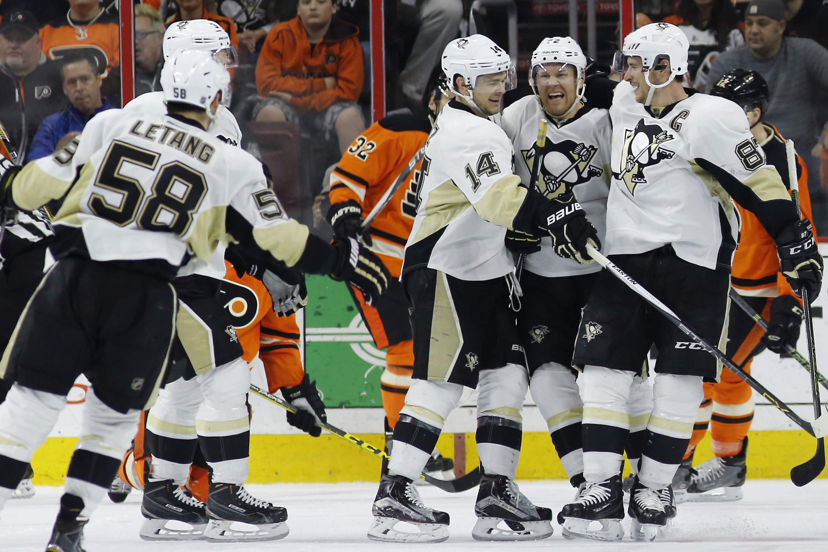 Pittsburgh Penguins' Sidney Crosby, from right, Patric Hornqvist, Chris Kunitz and Kris Letang celebrate after Kunitz's goal during the second period of an NHL hockey game against the Philadelphia Flyers, Saturday, March 19, 2016, in Philadelphia. (AP Pho
