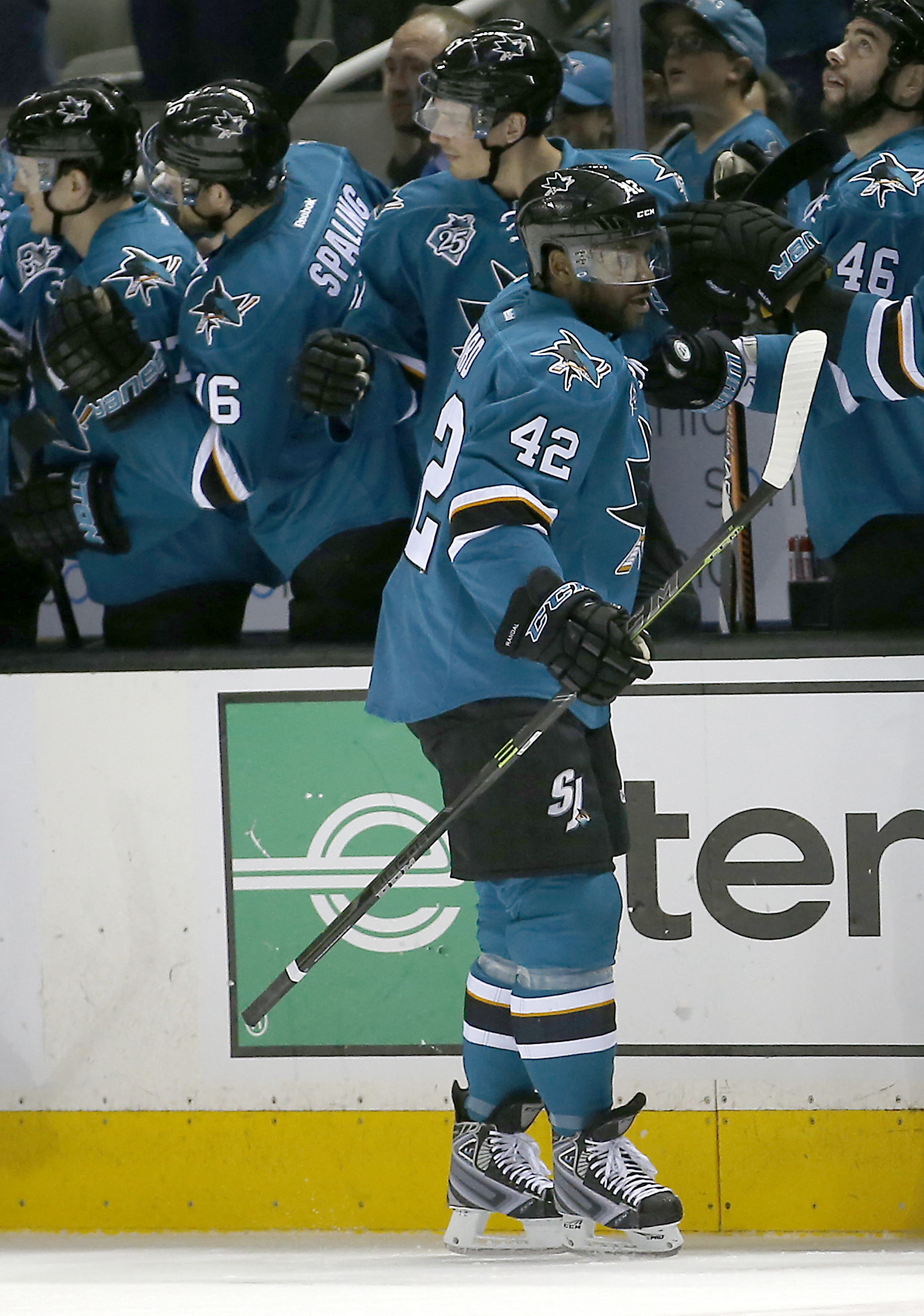 San Jose Sharks right wing Joel Ward (42) is congratulated by his teammates after scoring a goal against the New York Rangers during the second period of an NHL hockey game, Saturday, March 19, 2016, in San Jose, Calif. (AP Photo/Tony Avelar)