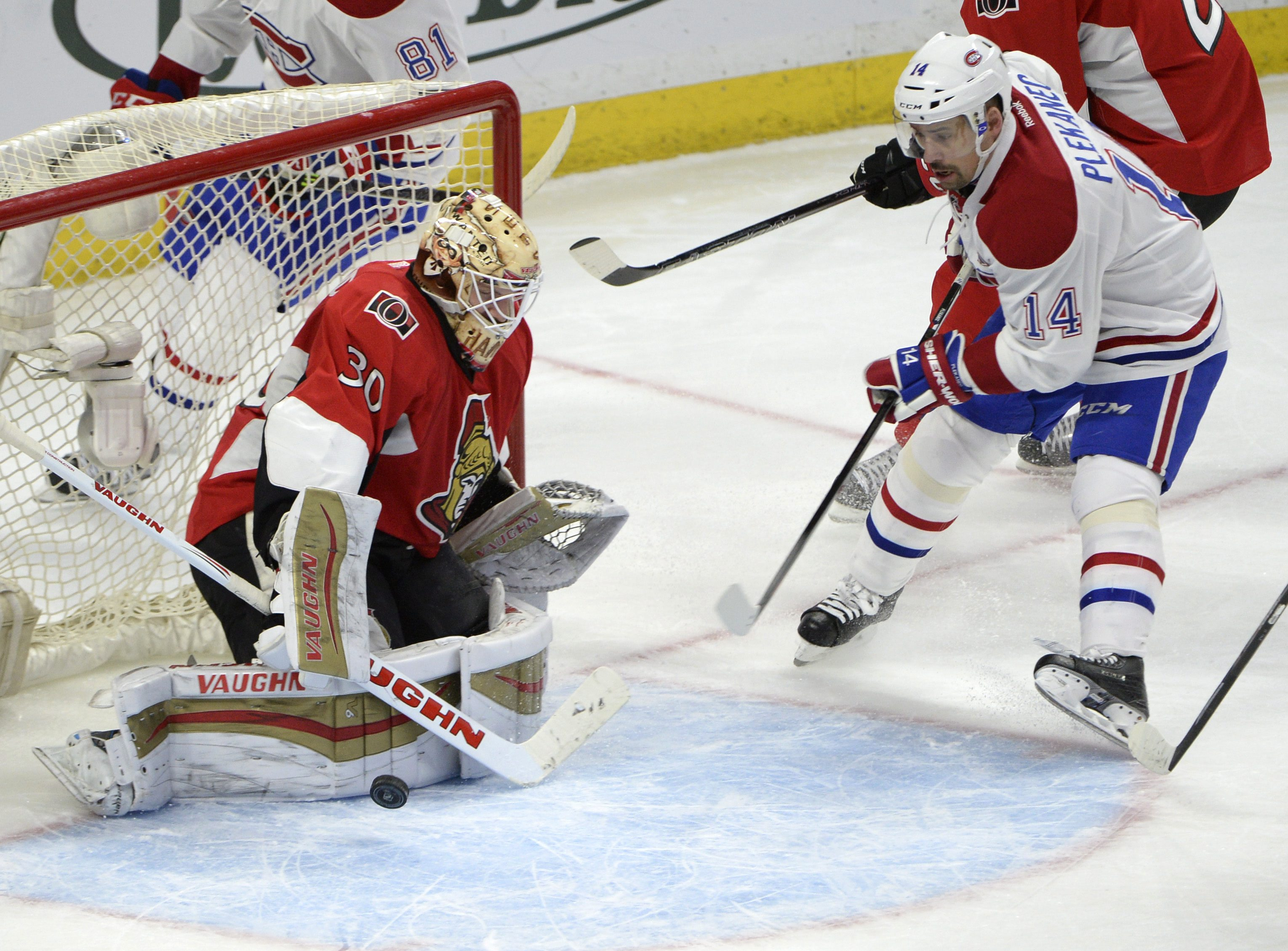 Montreal Canadiens' Tomas Plekanec (14) stops outside the crease as the puck passes Ottawa Senators goalie Andrew Hammond (30) during the second period of an NHL hockey game Saturday, March 19, 2016, in Ottawa, Ontario. (Justin Tang/The Canadian Press via